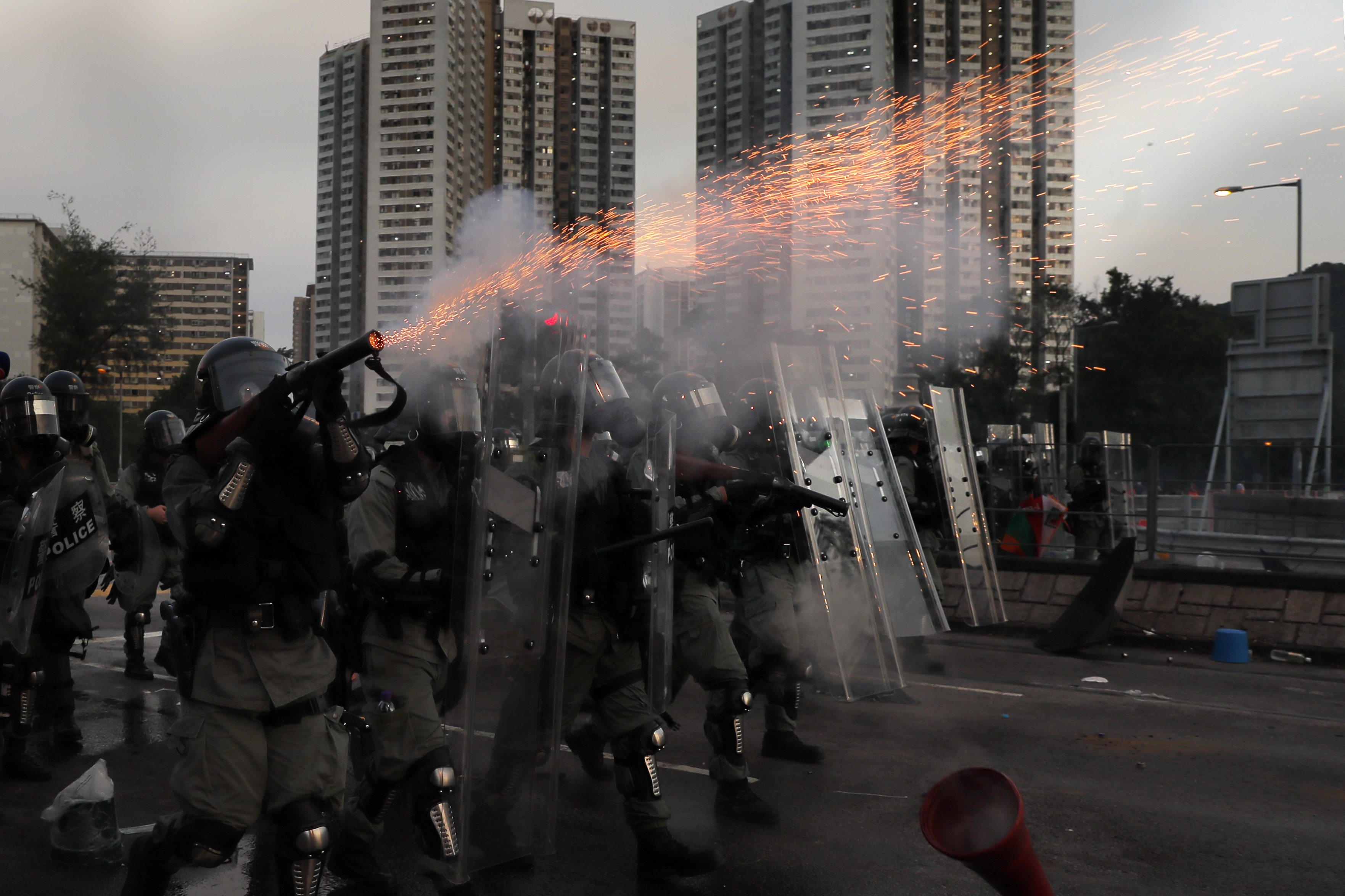 Riot police fire tear gas during a confrontation with protesters on August 5.