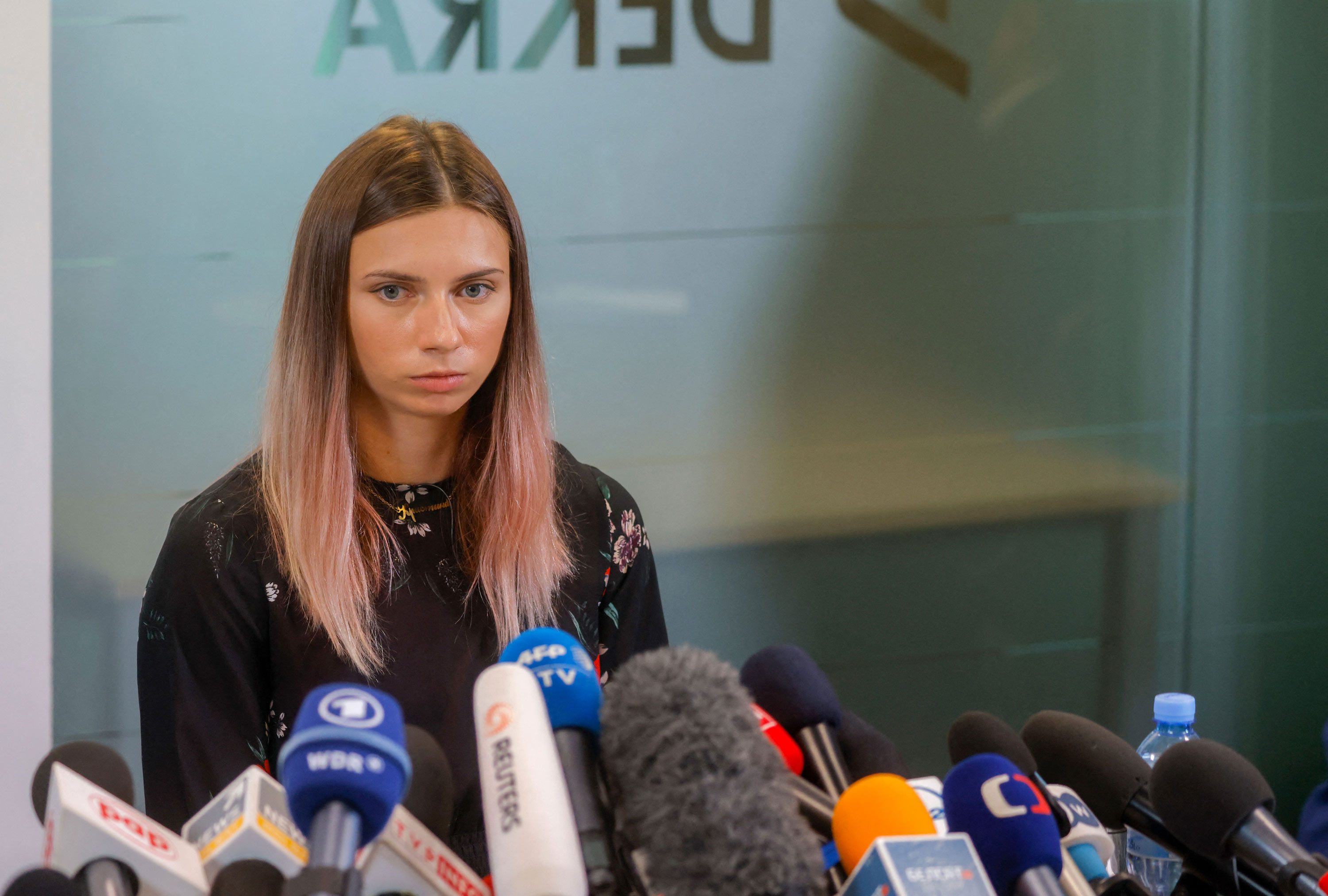 Belarusian Olympic athlete Kristina Timanovskaya addresses a press conference on August 5 in Warsaw, Poland.