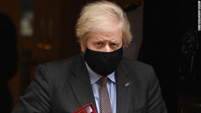 Prime Minister Boris Johnson leaves Downing Street in London for parliamentary questions on January 27.
