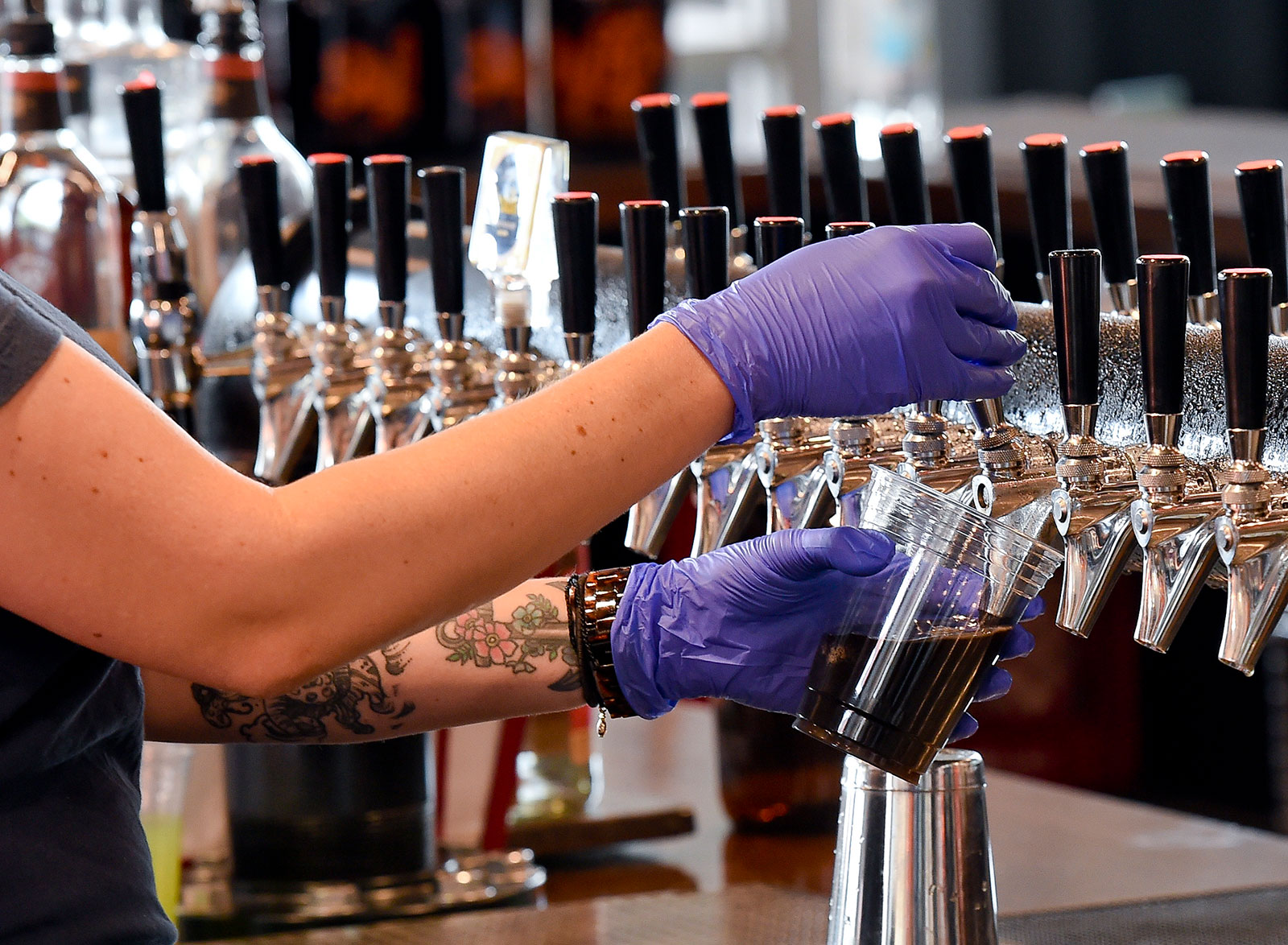 Holly Yoder pours a beer for a customer at the Sly Fox Taphouse in Wyomissing, Pennsylvania, in July.