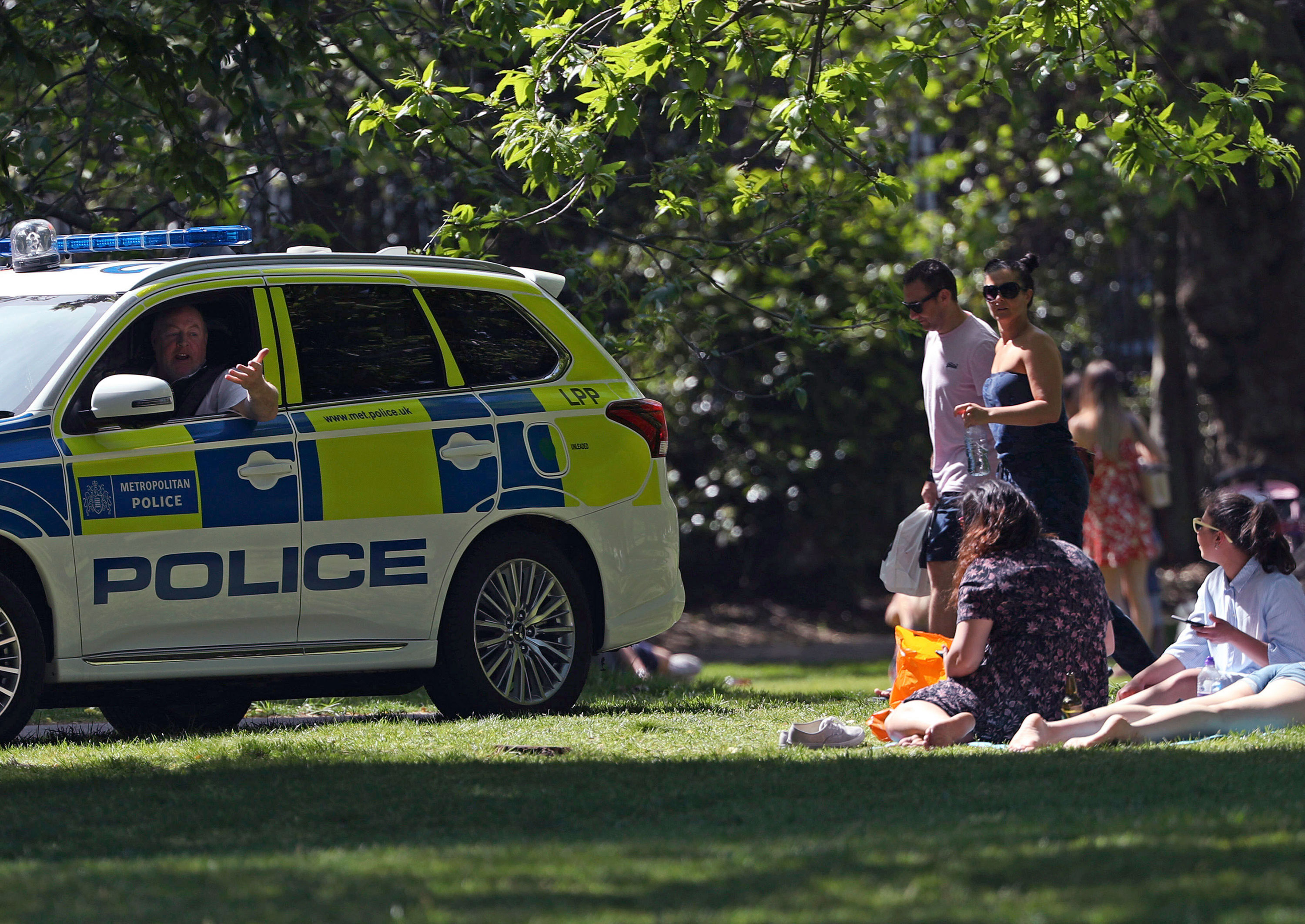 A police officer patrols in Greenwich Park in London, on May 9.