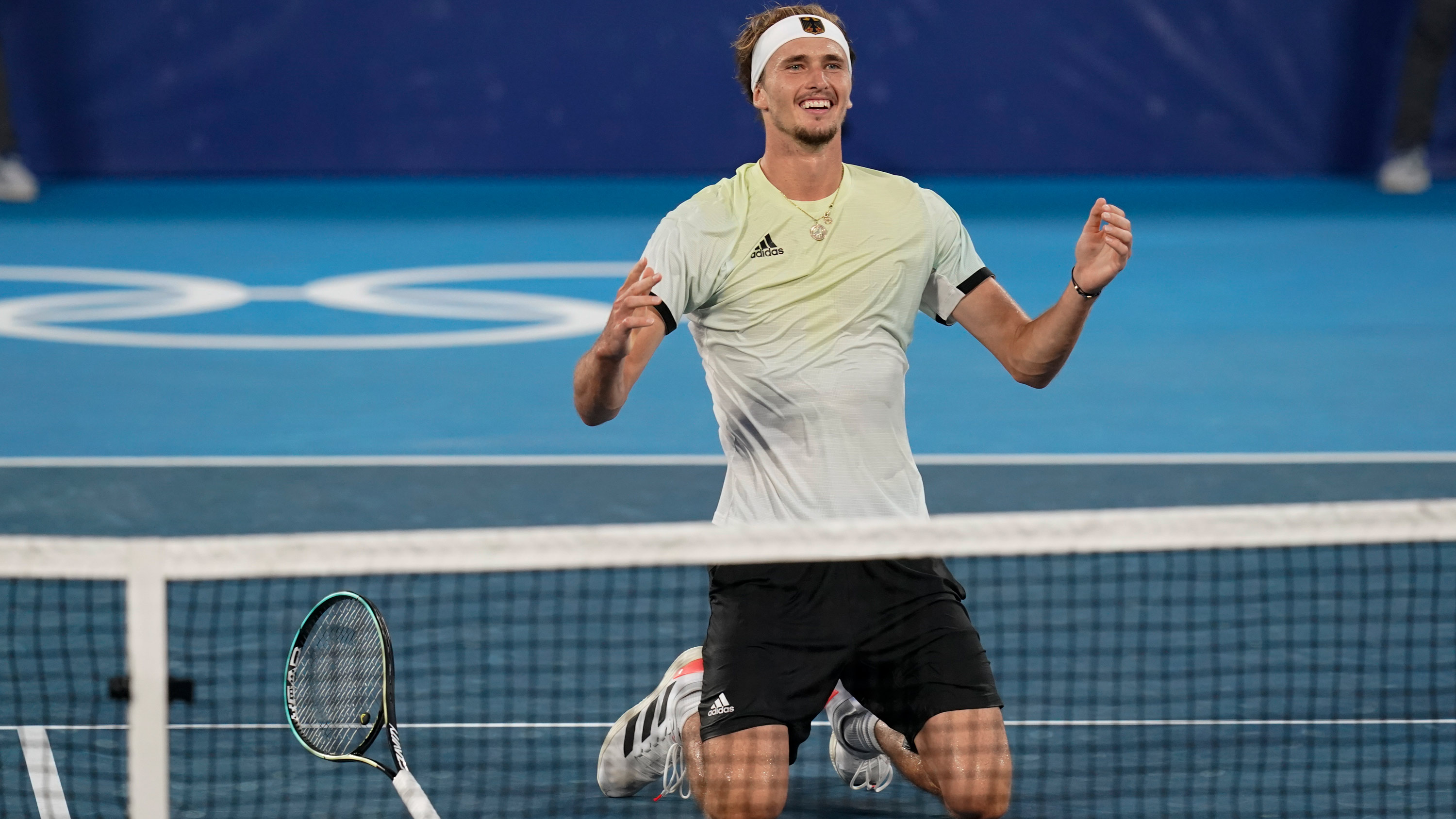 Germany's Alexander Zverev reacts after winning the tennis single's gold against the ROC's Karen Khachanov on August 1.