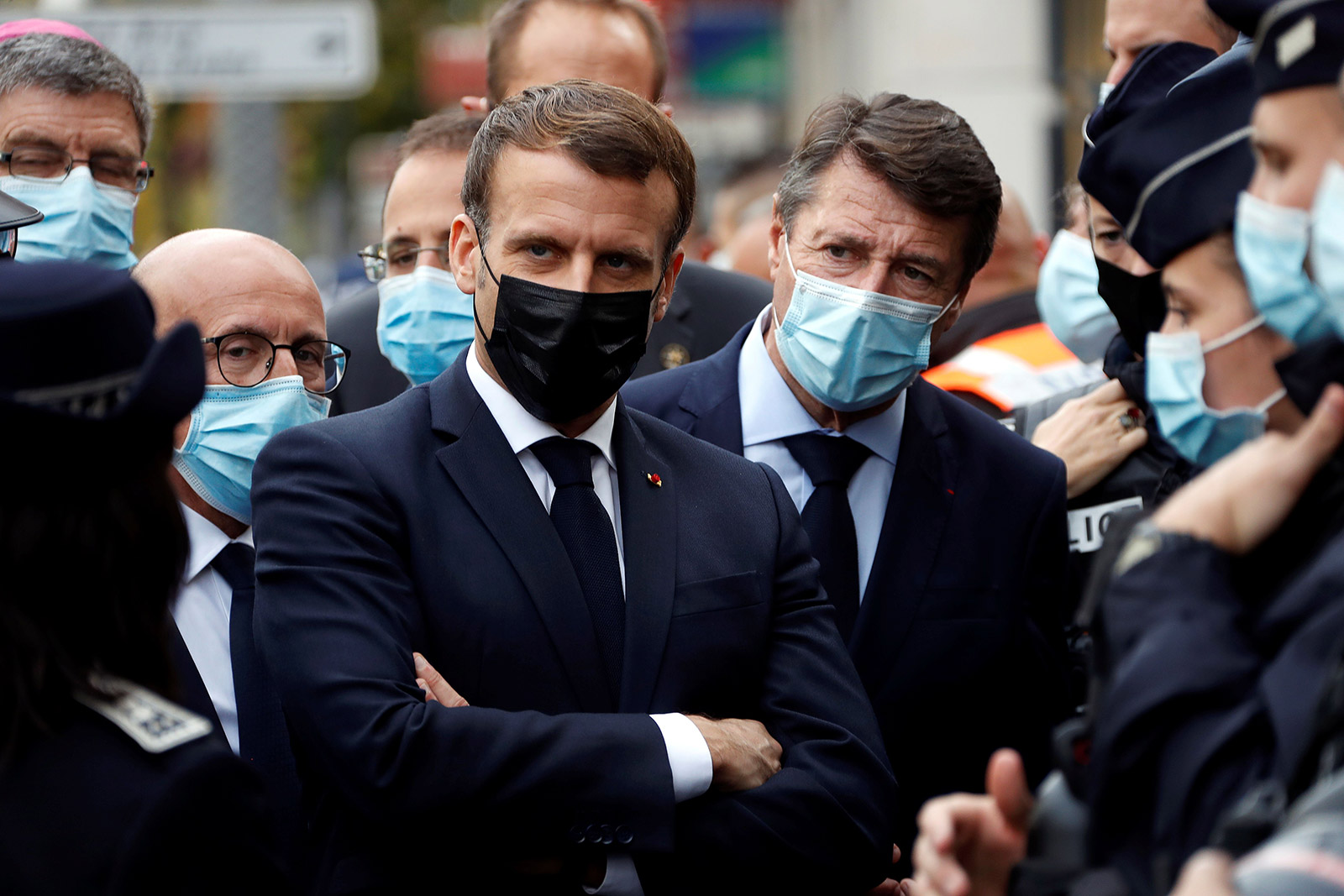 French President Emmanuel Macron visits the scene of the knife attack in Nice.