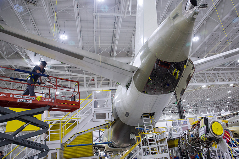 A worker prepares to install an engine on an Airbus SE A220 plane on the assembly line at the Airbus Canada LP assembly and finishing site in Mirabel, Quebec, Canada, on February 20.