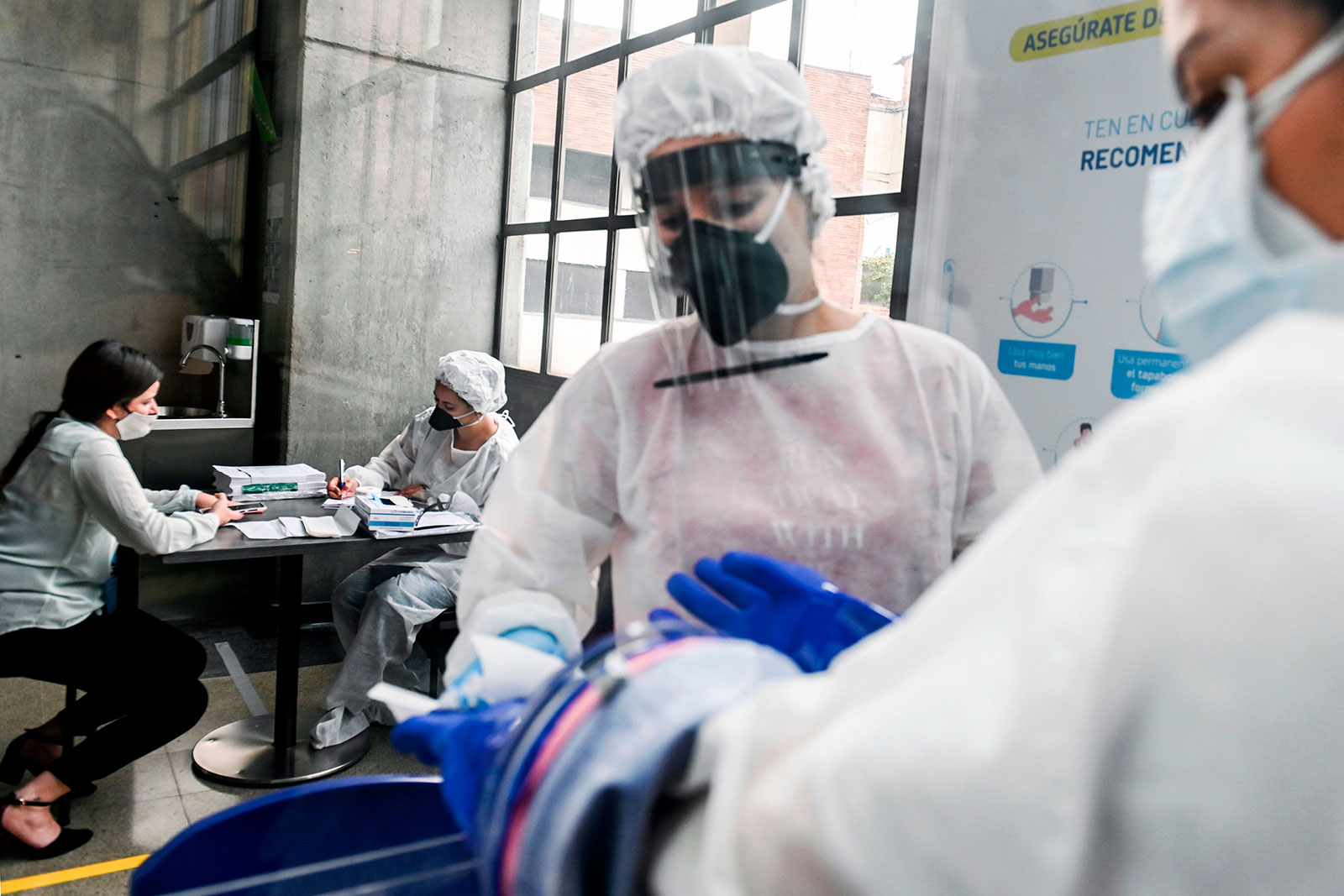 Health workers prepare to test people for coronavirus at a metro station in Medellin, Colombia, on July 6.
