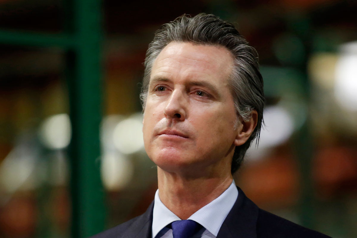 Governor Gavin Newsom listens to a reporter's question during a news conference in Rancho Cordova, California on June 26.
