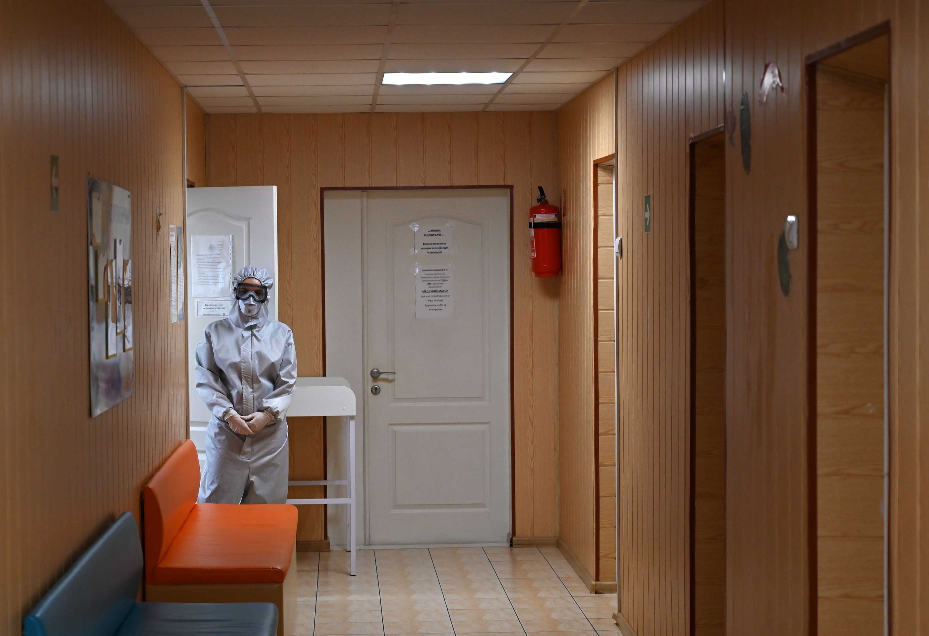 A medical worker waits for patients inside a clinic in the Ukrainian town of Irpin on April 15.