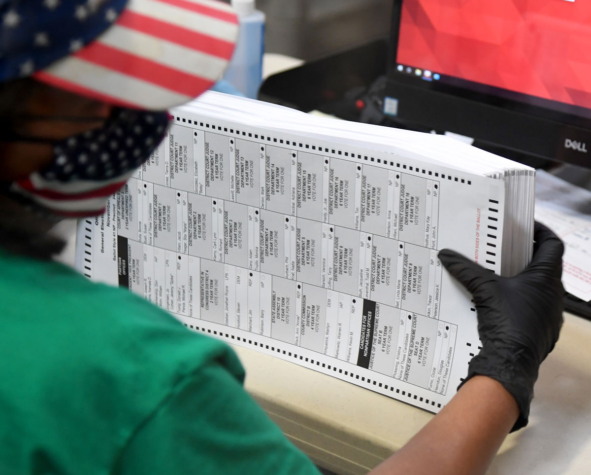 An election worker scans mail-in ballots at the Clark County Election Department on November 7 in North Las Vegas, Nevada.