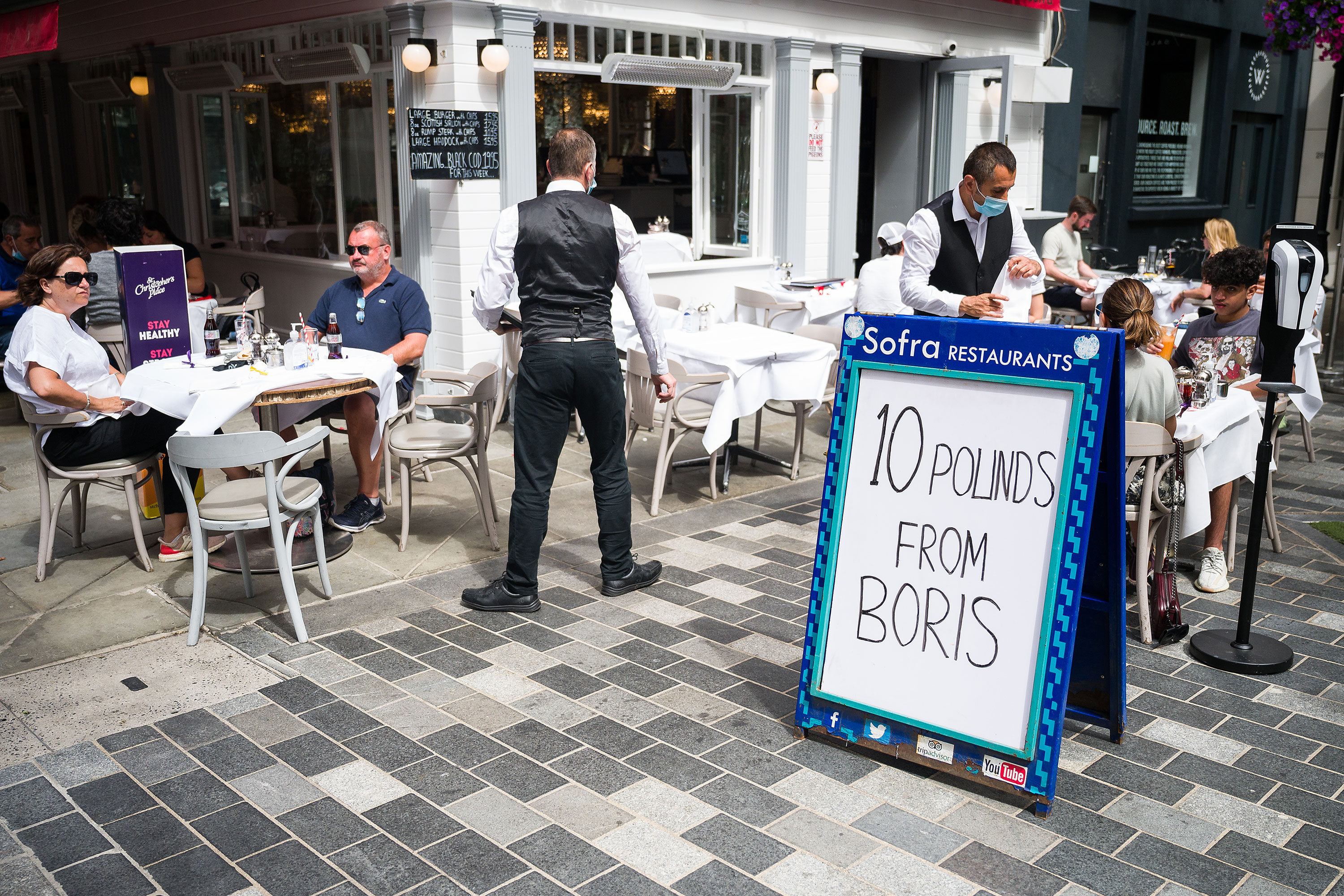 """A sign advertises the """"Eat Out to Help Out"""" discount at a restaurant in London on August 5."""