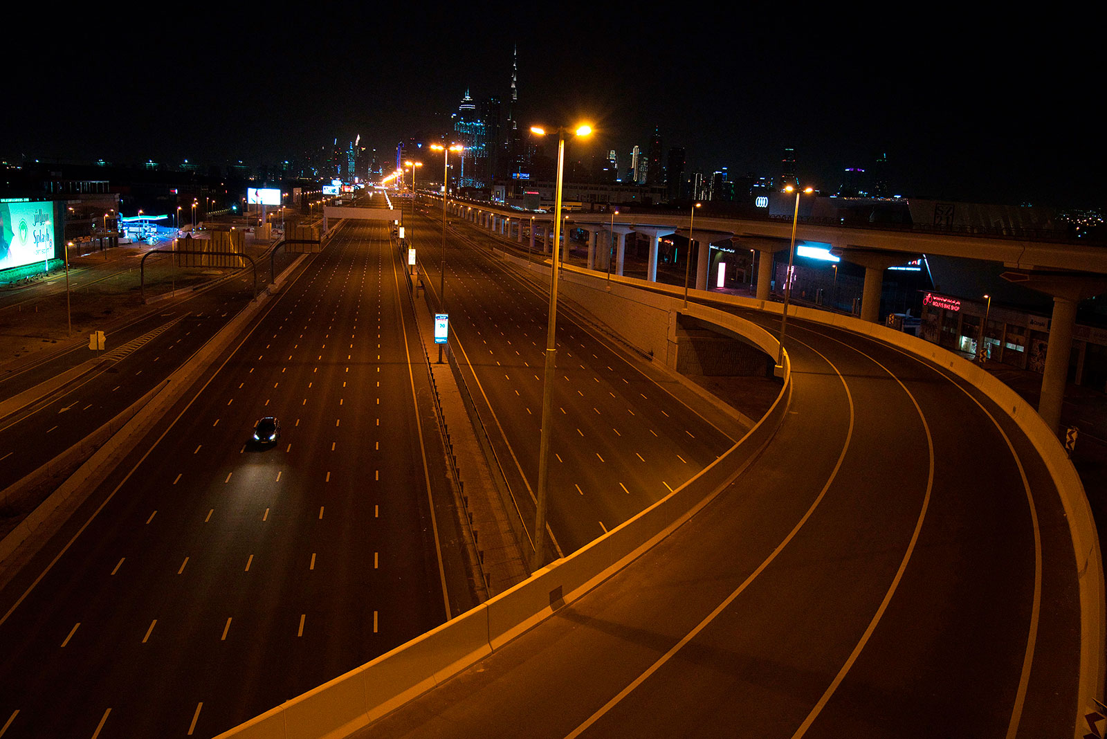 A car travels down nearly empty road in Dubai on Tuesday, March 31.