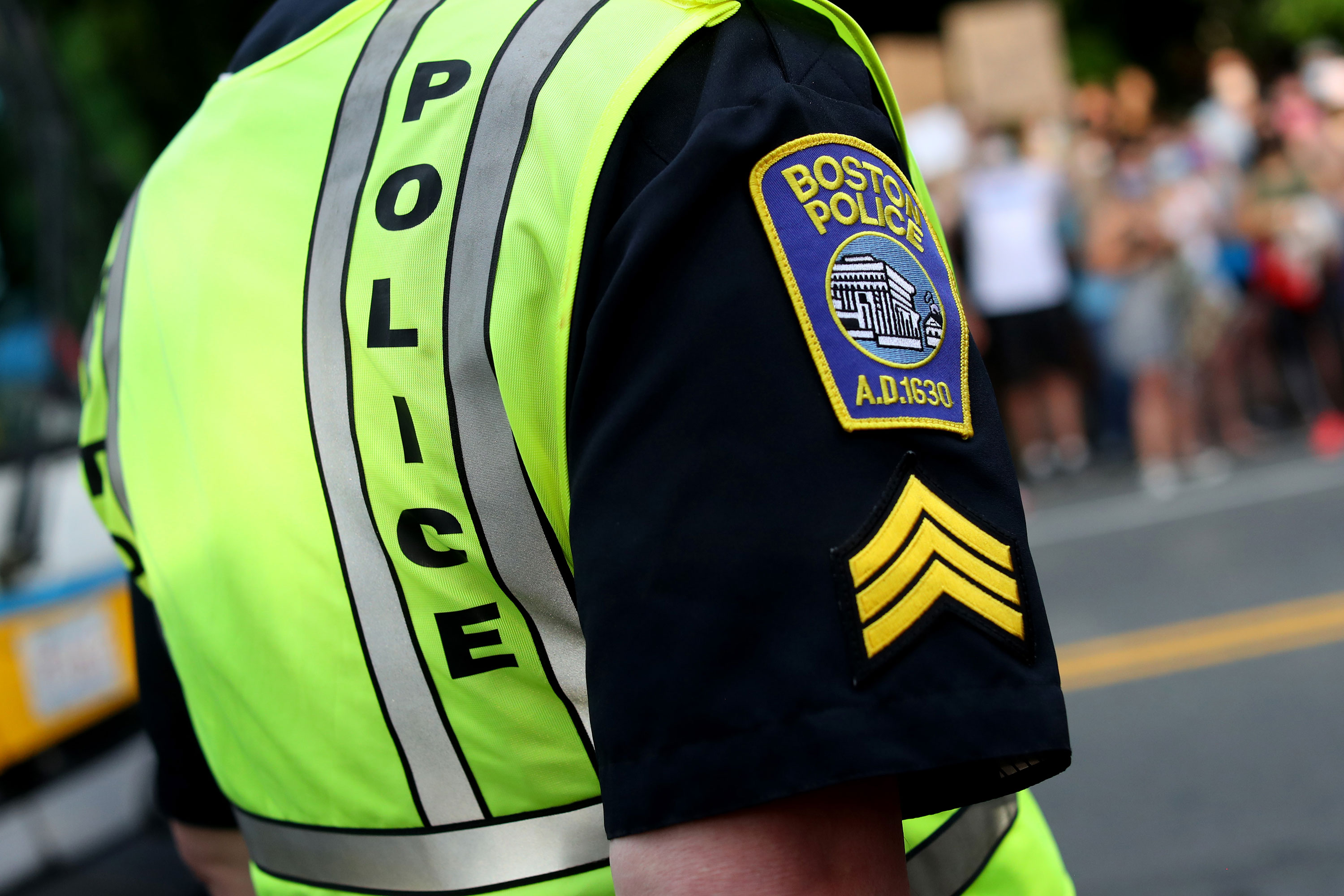 A Boston Police officer stands beside a protest on June 4 in Boston, Massachusetts.