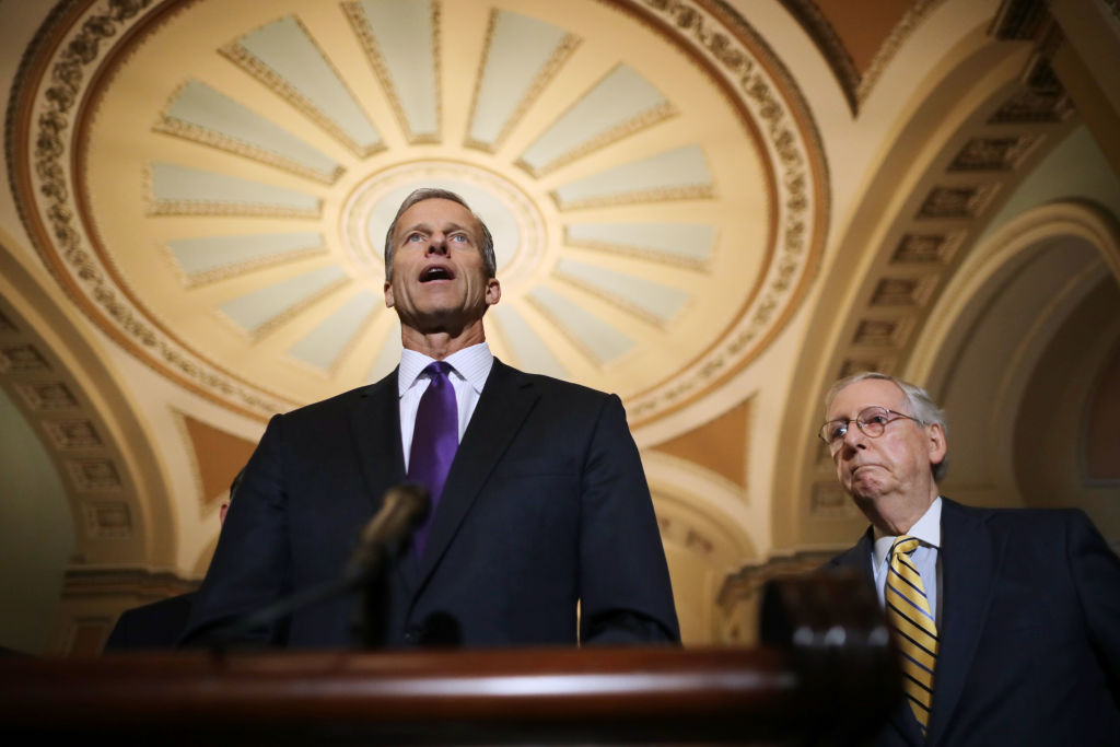 In this Oct. 2 file photo, Sen. John Thune (R-SD) and Senate Majority Leader Mitch McConnell (R-KY) talk to reporters at the US Capitol.