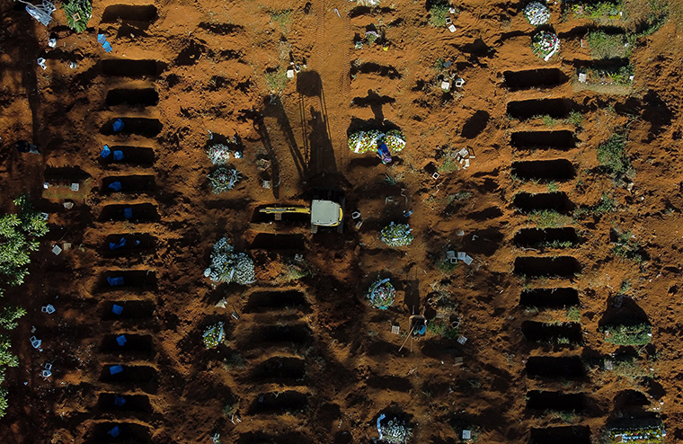 An aerial view of open graves amidst the coronavirus pandemic at Vila Formosa Cemetery on Monday, May 18, in Sao Paulo, Brazil. T