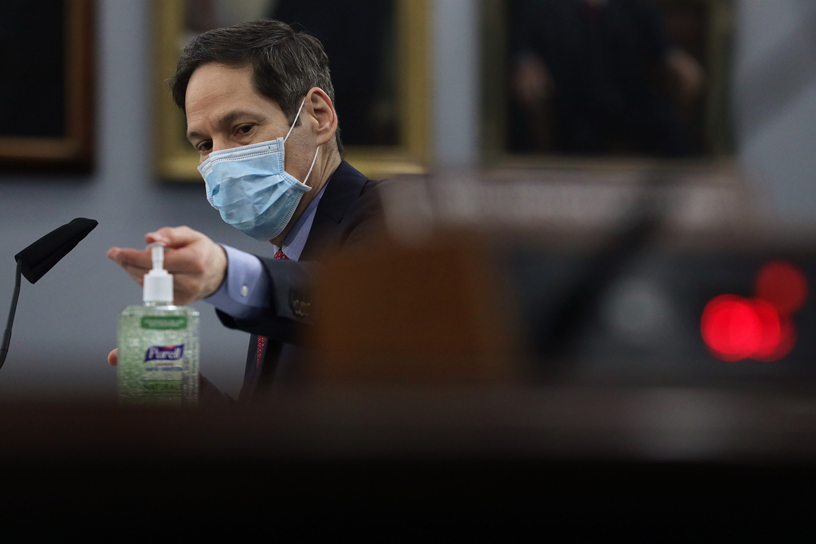 Former Director of the Centers for Disease Control and Prevention Dr. Tom Frieden uses hand sanitizer during a hearing on May 6 in Washington.