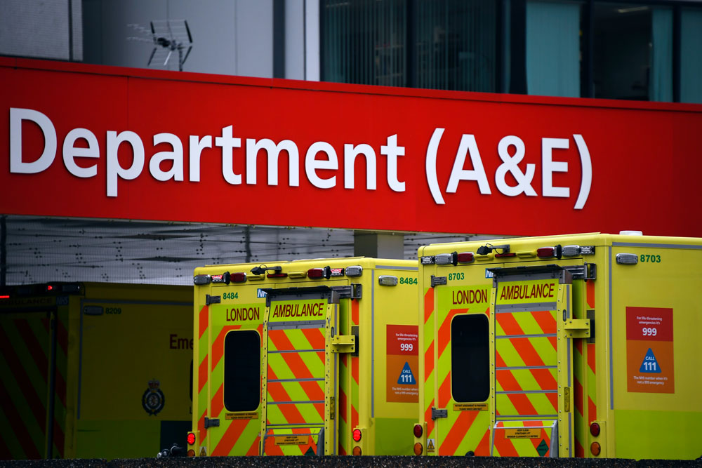 Ambulances are parked outside the Emergency Department of St Thomas' Hospital, one of the many hospitals dealing with coronavirus patients in London, on Wednesday, April 1.