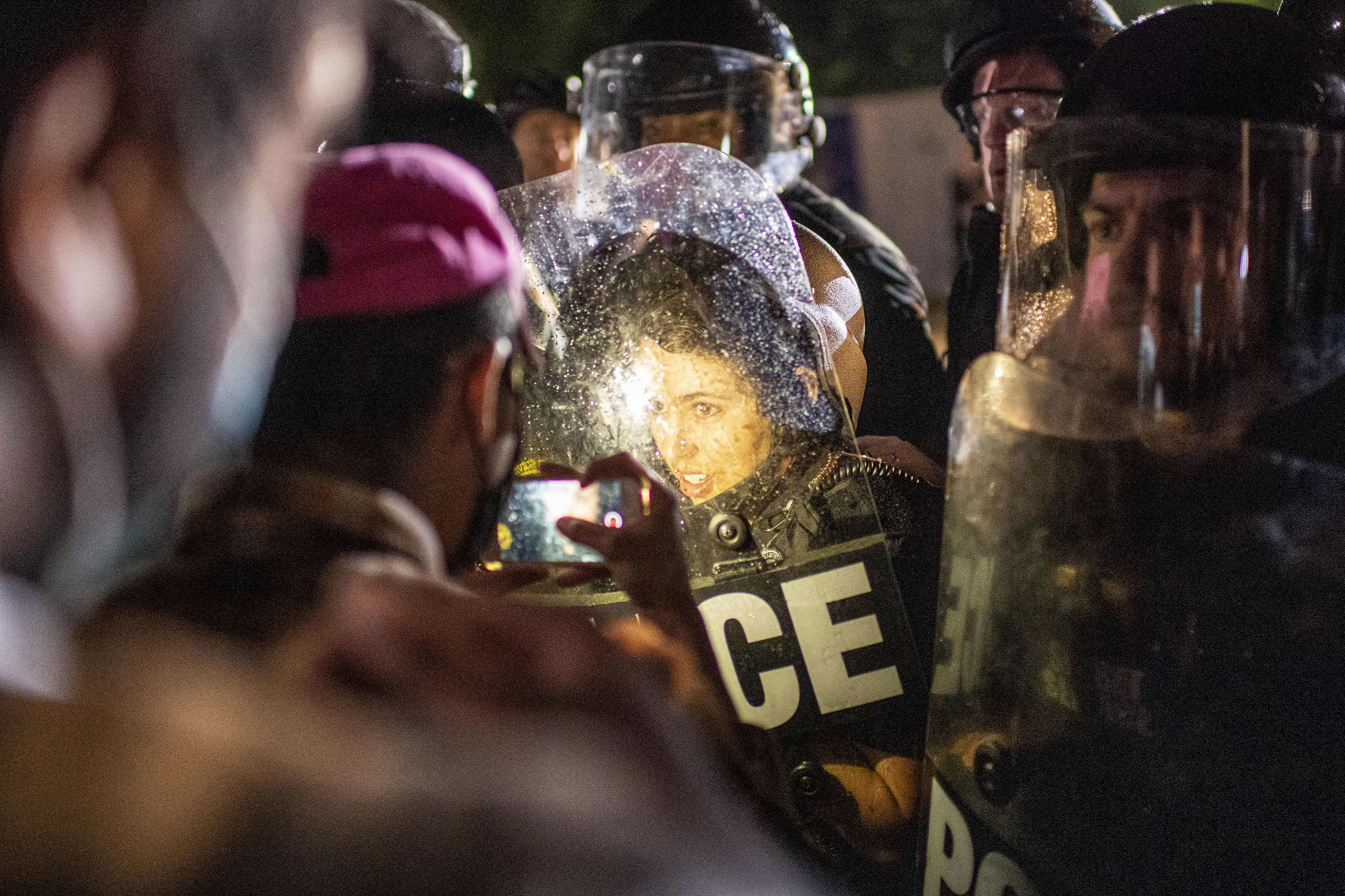 Protesters face off with police outside the White House in Washington in the early hours of May 30.