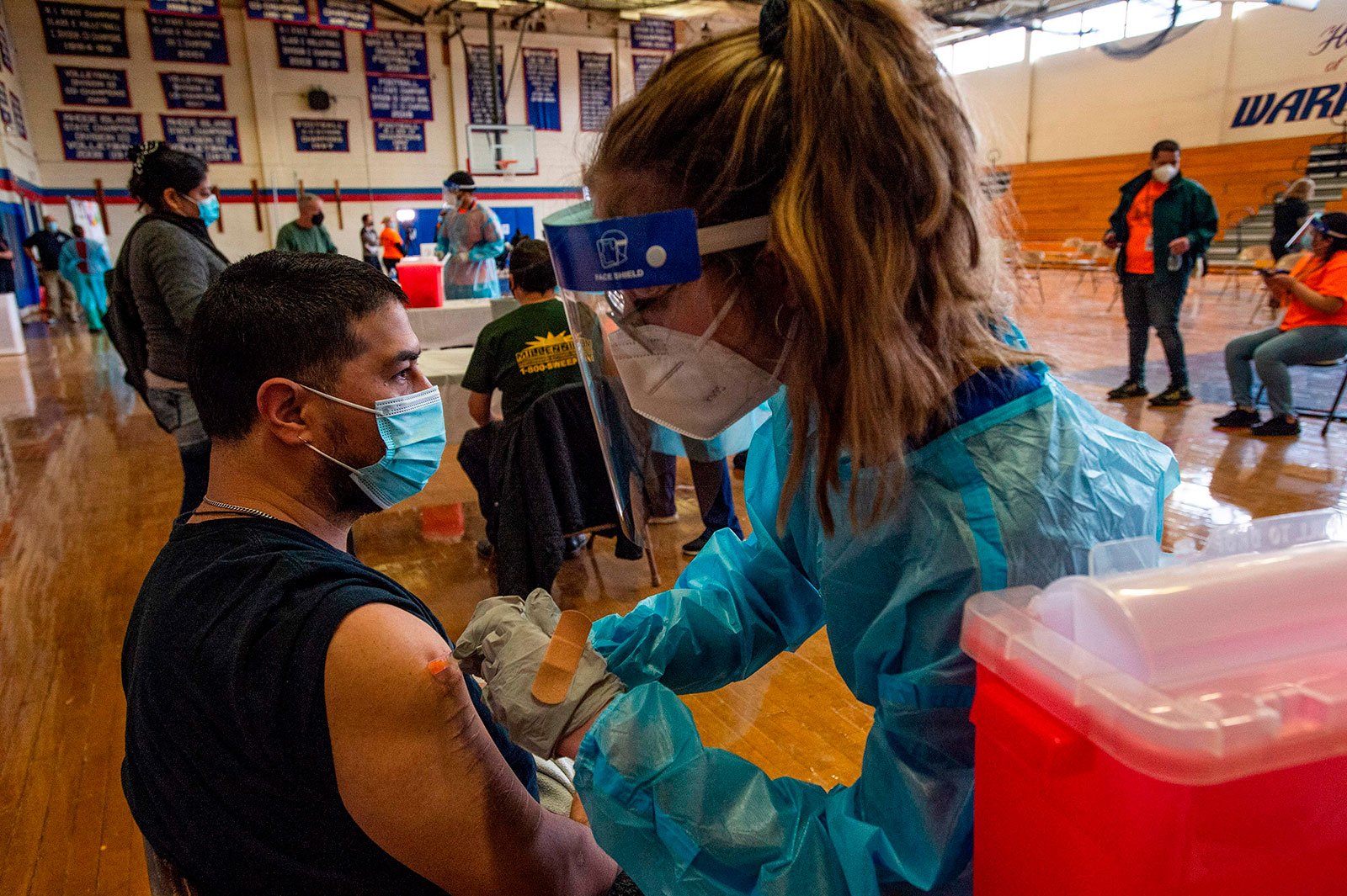 Alejandro Uribe is vaccinated at Central Falls High School in Rhode Island on February 13.
