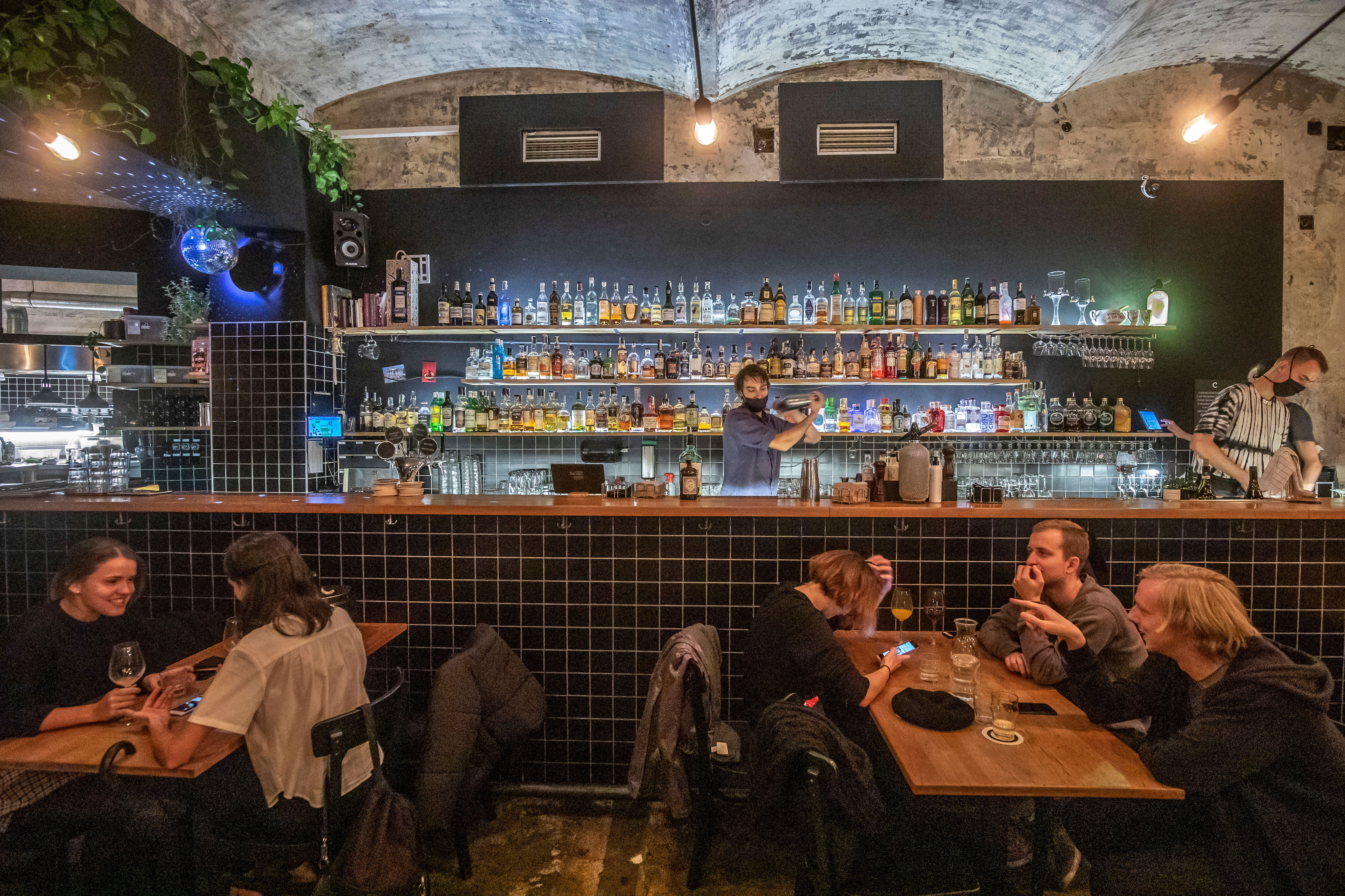 Customers drink in a bar shortly before closing time in Prague, Czech Republic, on October 10.