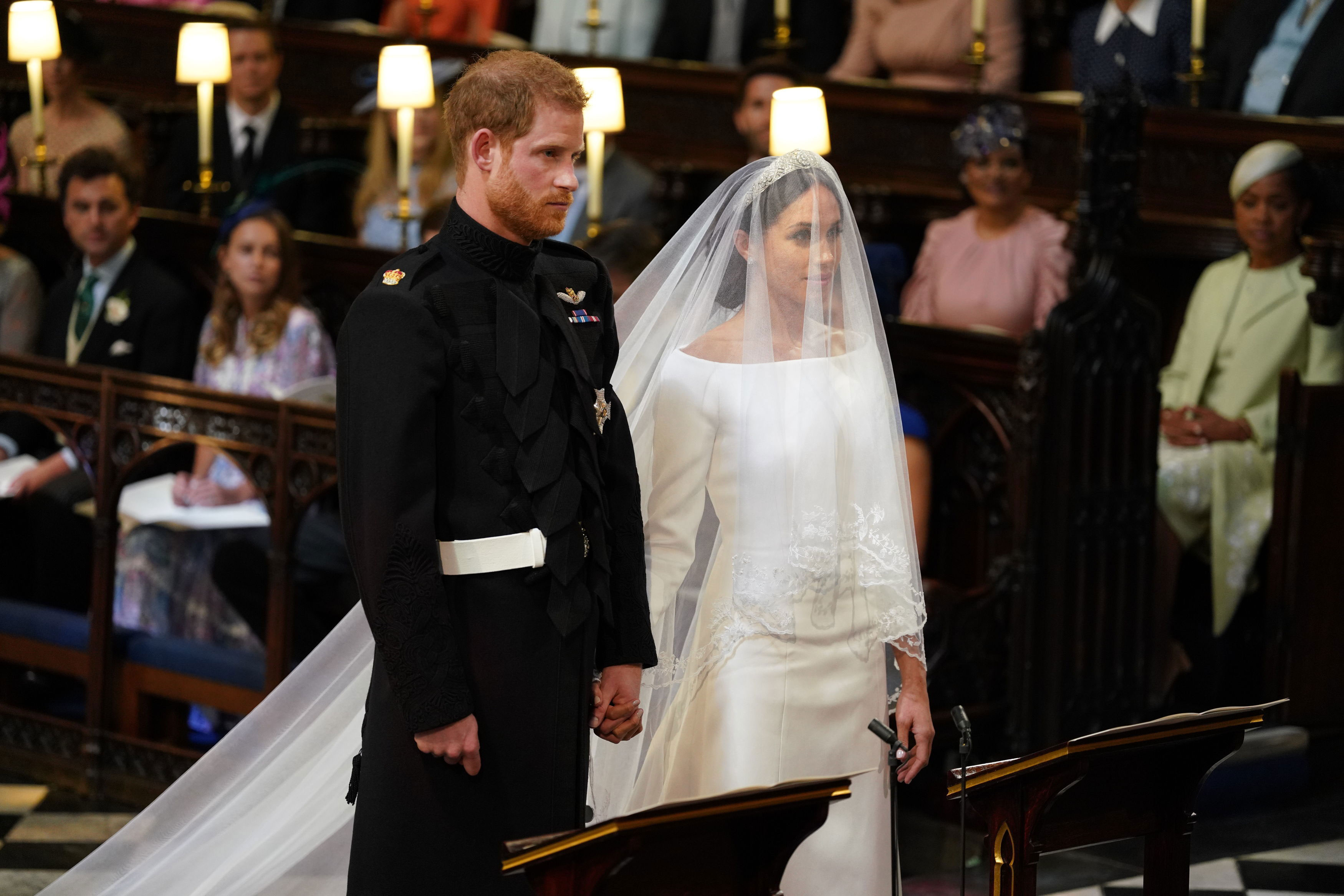 Prince Harry and Meghan Markle stand together during their wedding at St George's Chapel in Windsor, England, on May 19, 2018.