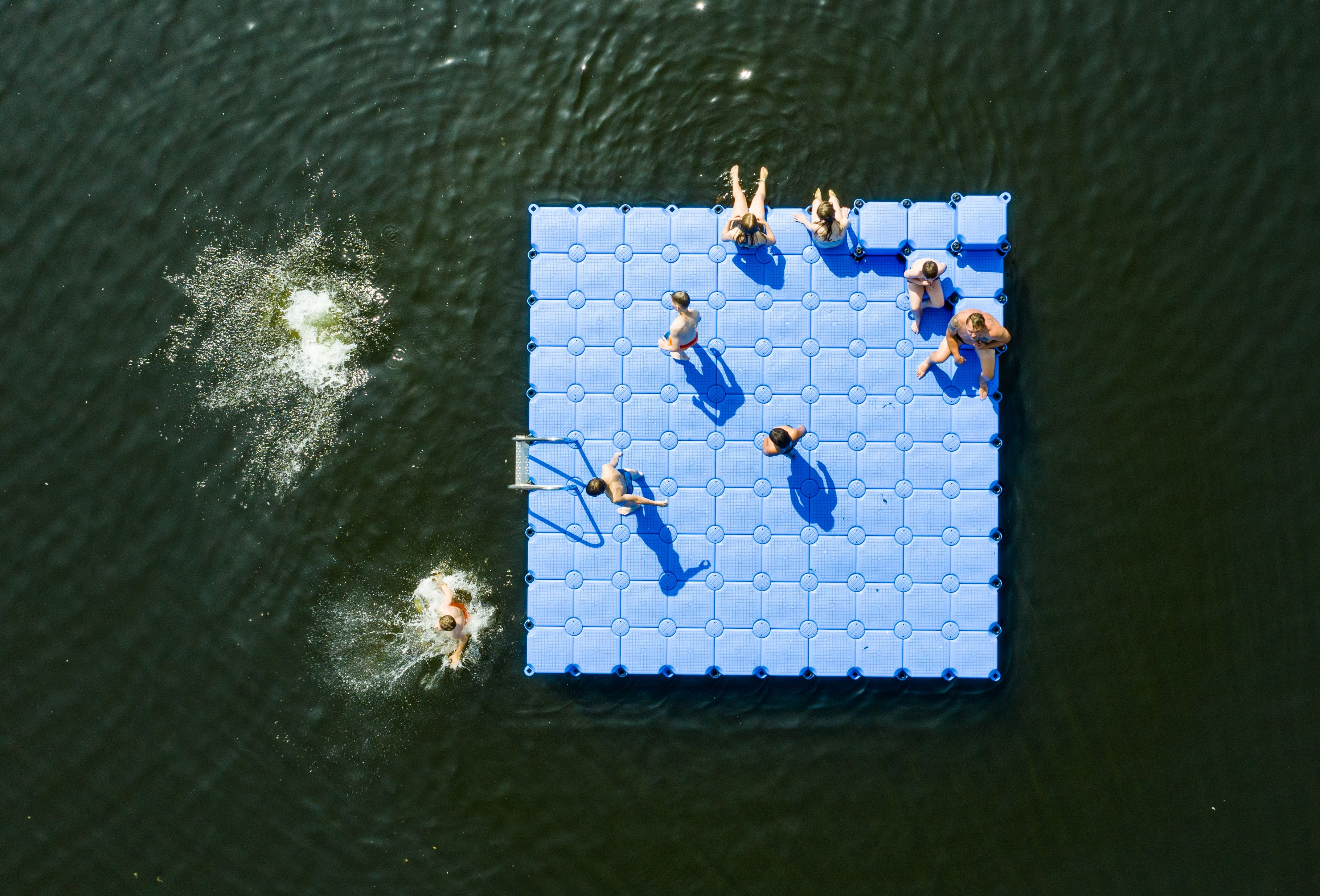 Swimmers sunbathe on a float on the Altwarmbuechener See lake in Hanover, northern Germany, where temperatures were predicted to reach 39 Celsius (102 degrees Fahrenheit). (Christophe Gateau/DPA/AFP)