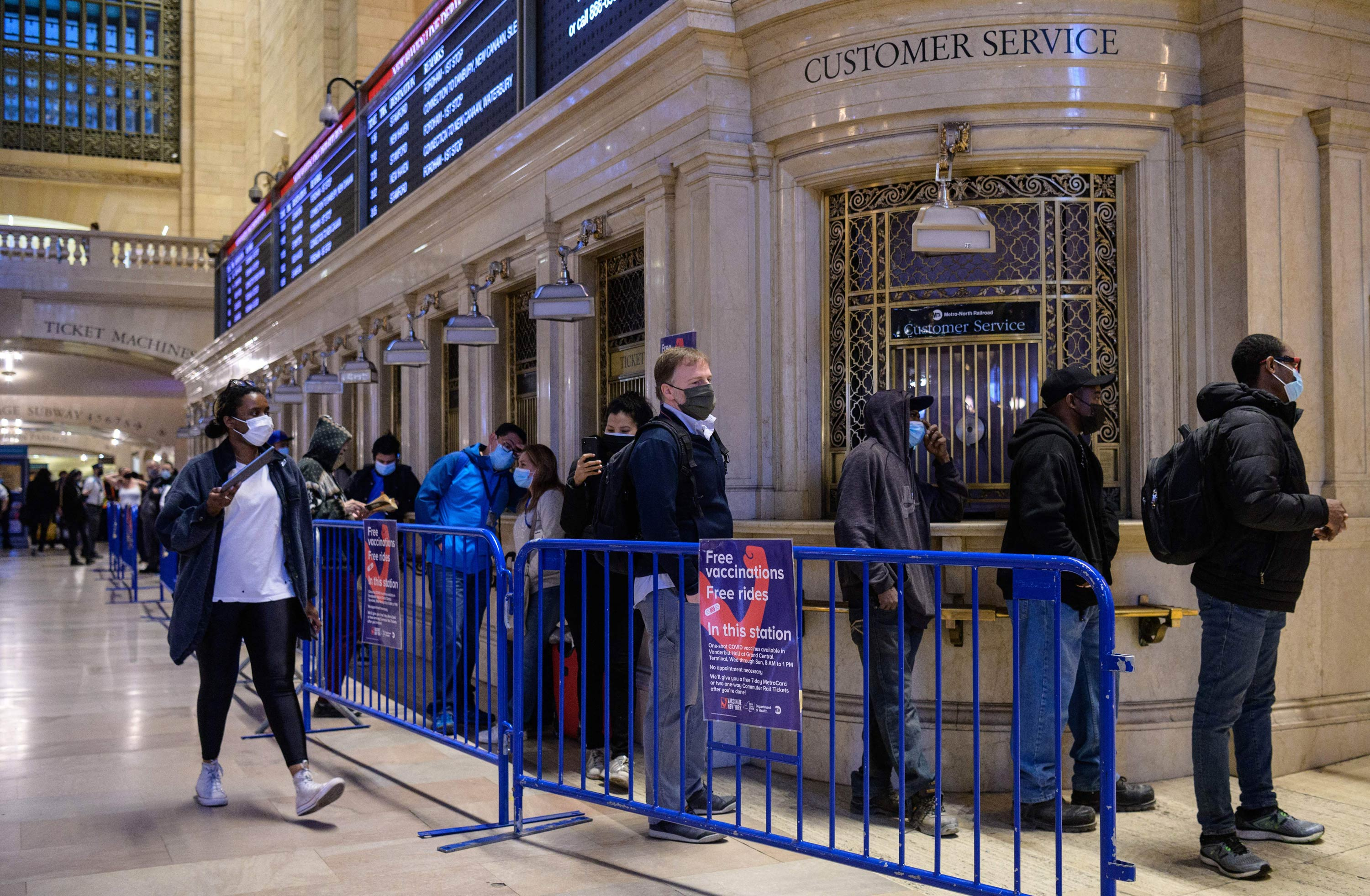 People stand in line to receive the Covid-19 vaccine at a temporary vaccination site at Grand Central Terminal train station on May 12 in New York City.