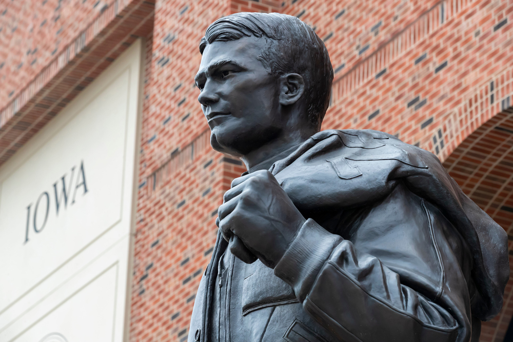 A statue of Nile Clarke Kinnick Jr., former student and a college football player at the University of Iowa, is seen on campus on July 21, 2019.