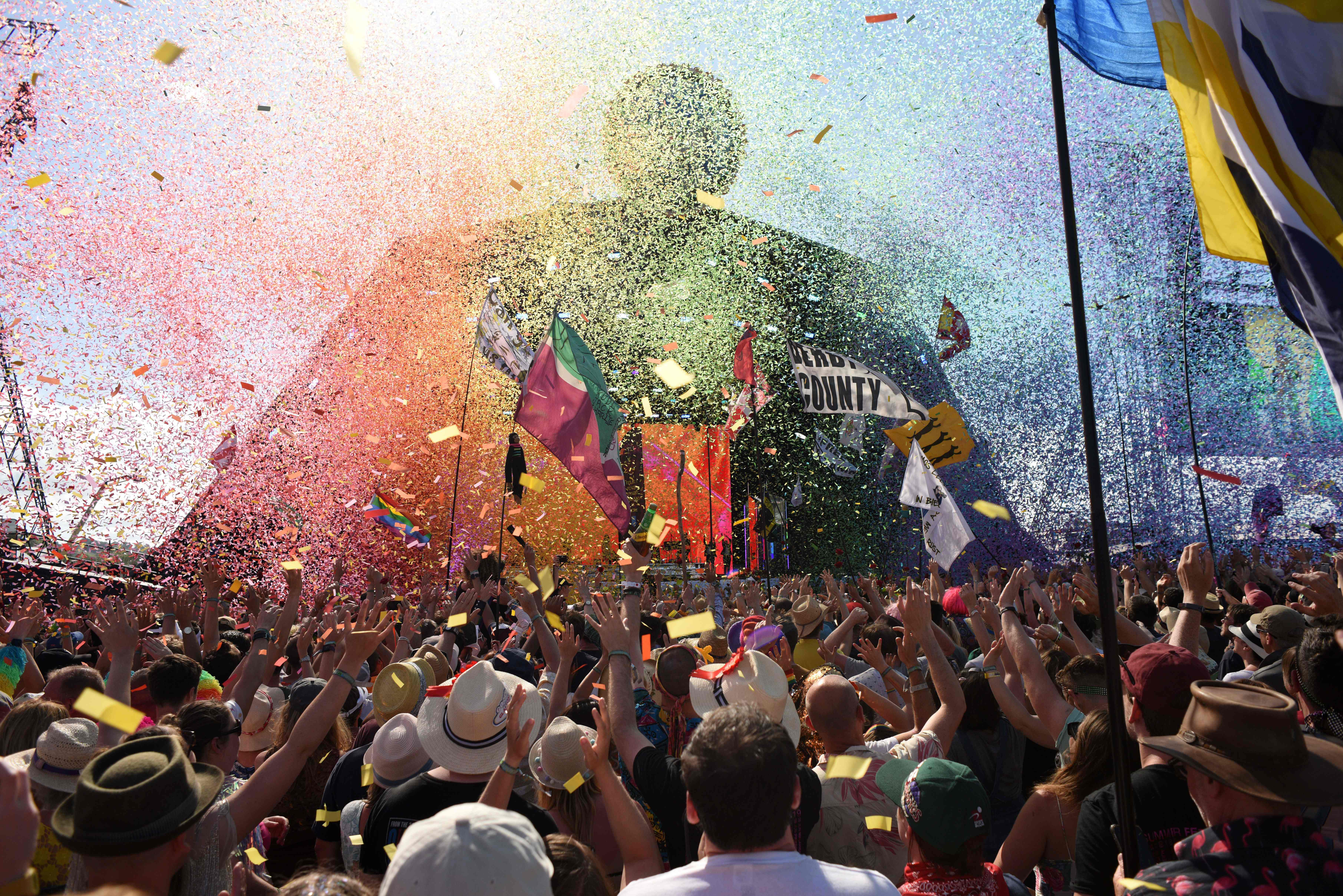 People cheer as singer Kylie prepares to perform at the Glastonbury Festival in Pilton, England, on June 30, 2019.