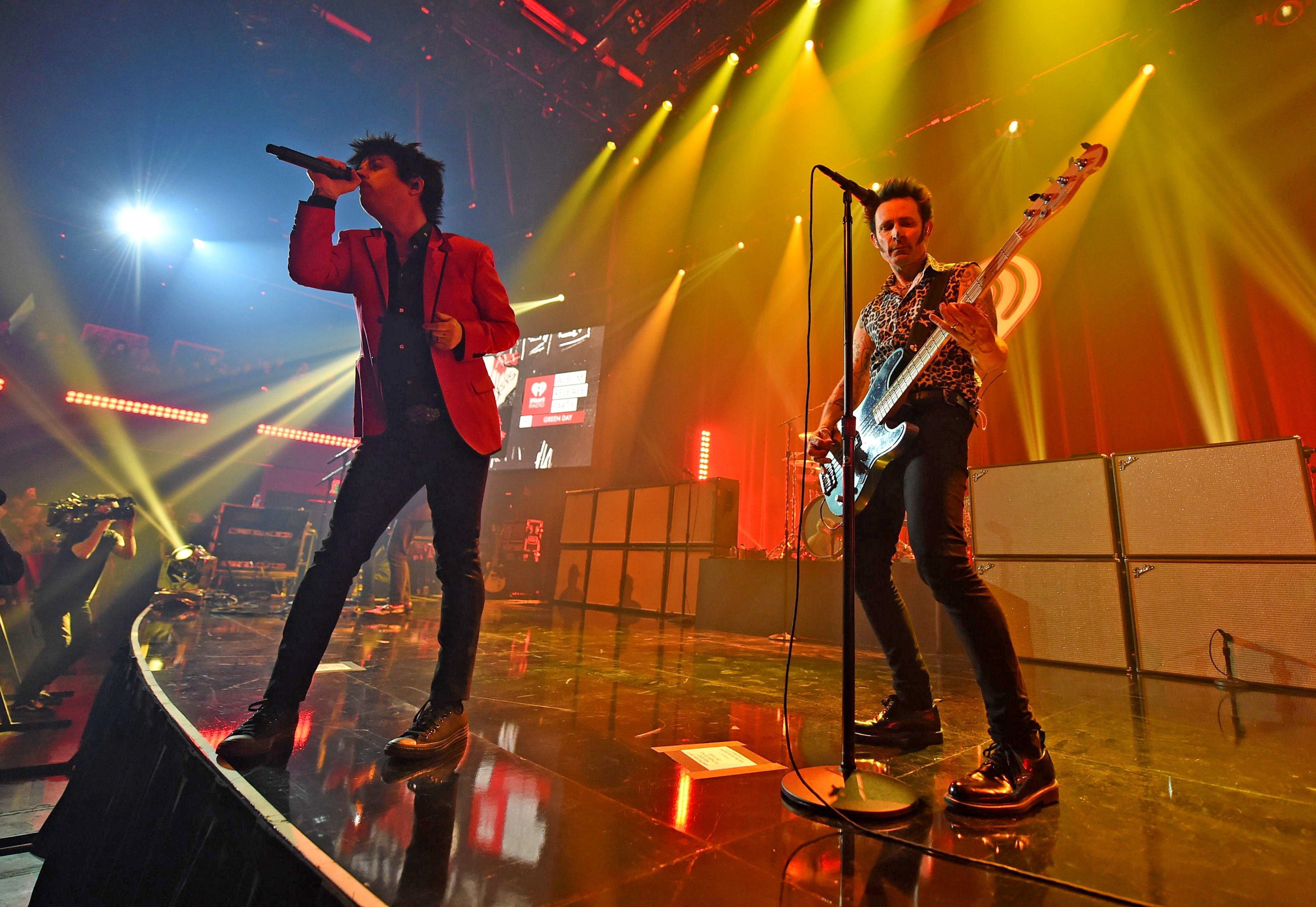 Billie Joe Armstrong and Mike Dirnt of Green Day perform onstage during the iHeartRadio Album Release Party on February 7 in Burbank, California.