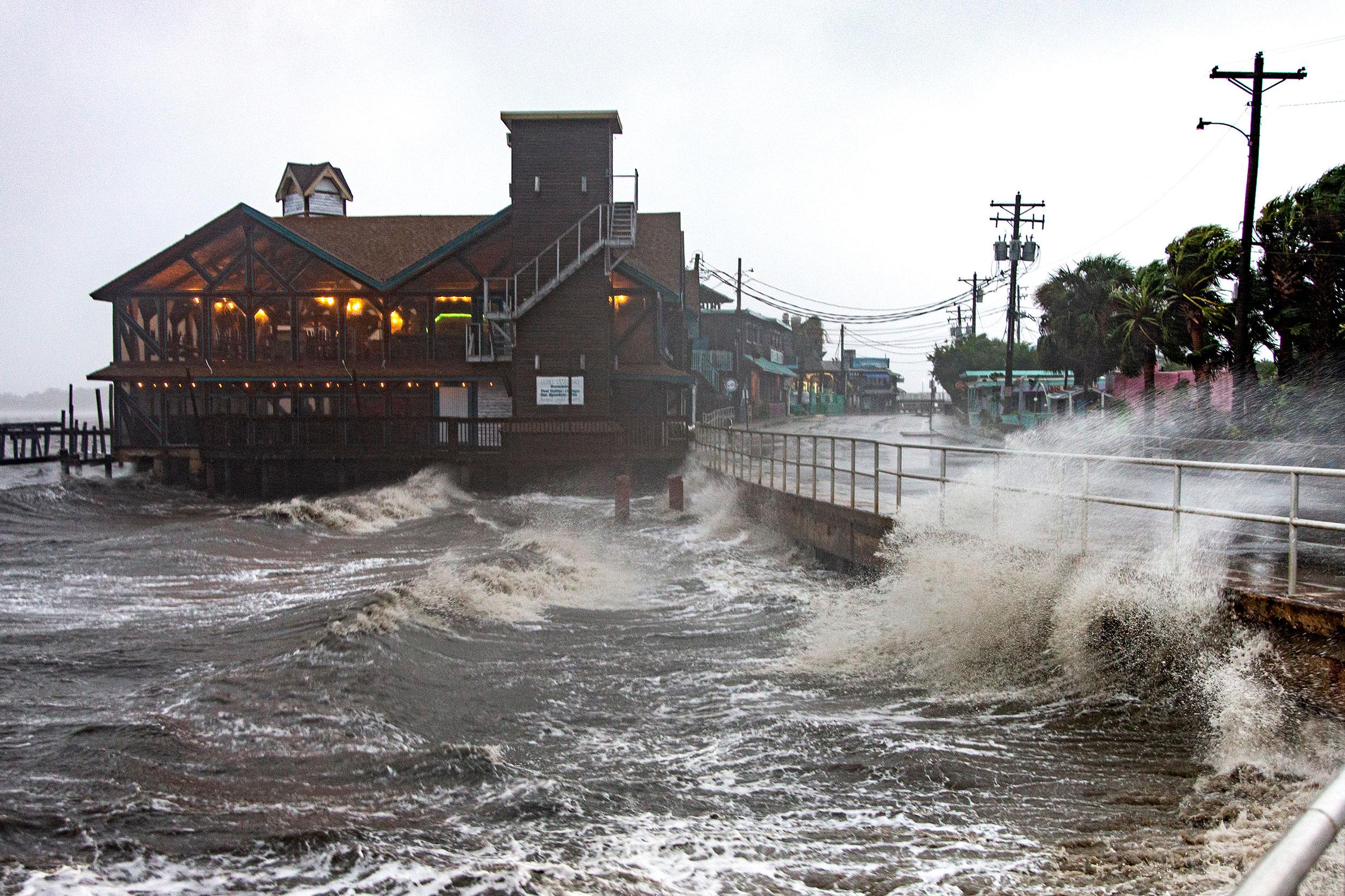 Waves crash ashore in Cedar Key, Florida, on July 7.
