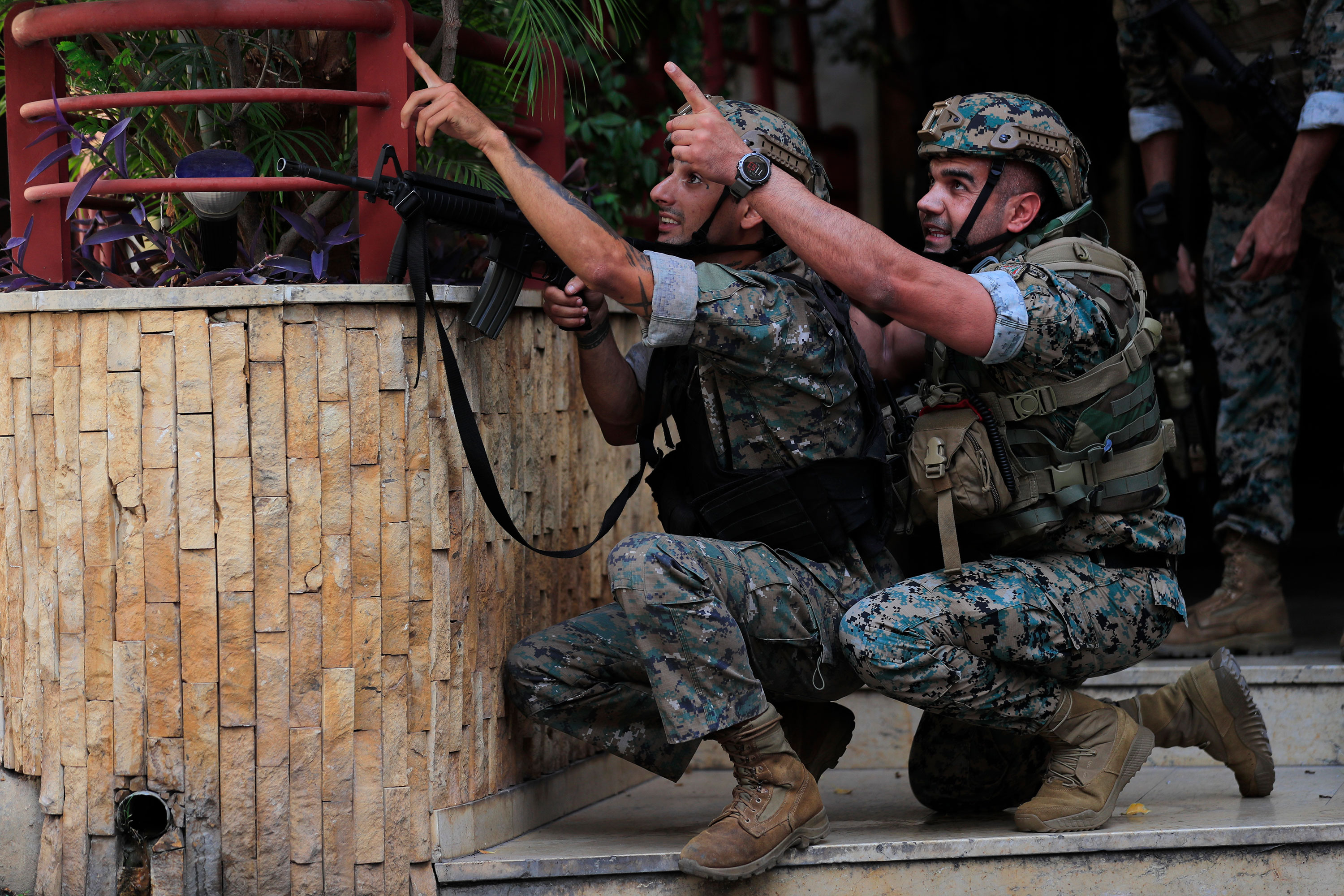 Lebanese security forces react to gunfire during a protest in Beirut on October 14.