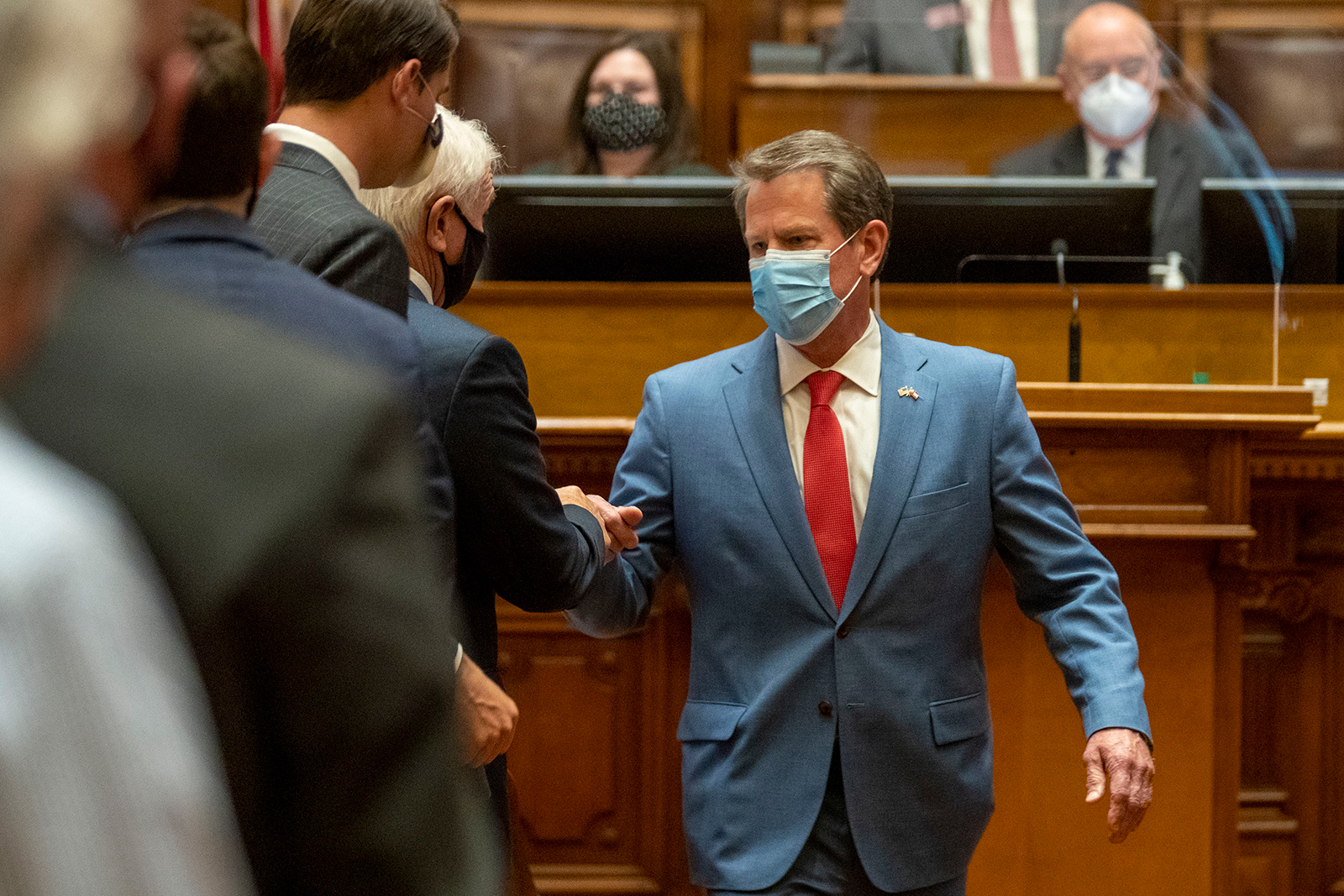 Brian Kemp is greeted as he visits the House Chambers in Atlanta, on Friday, June 26.