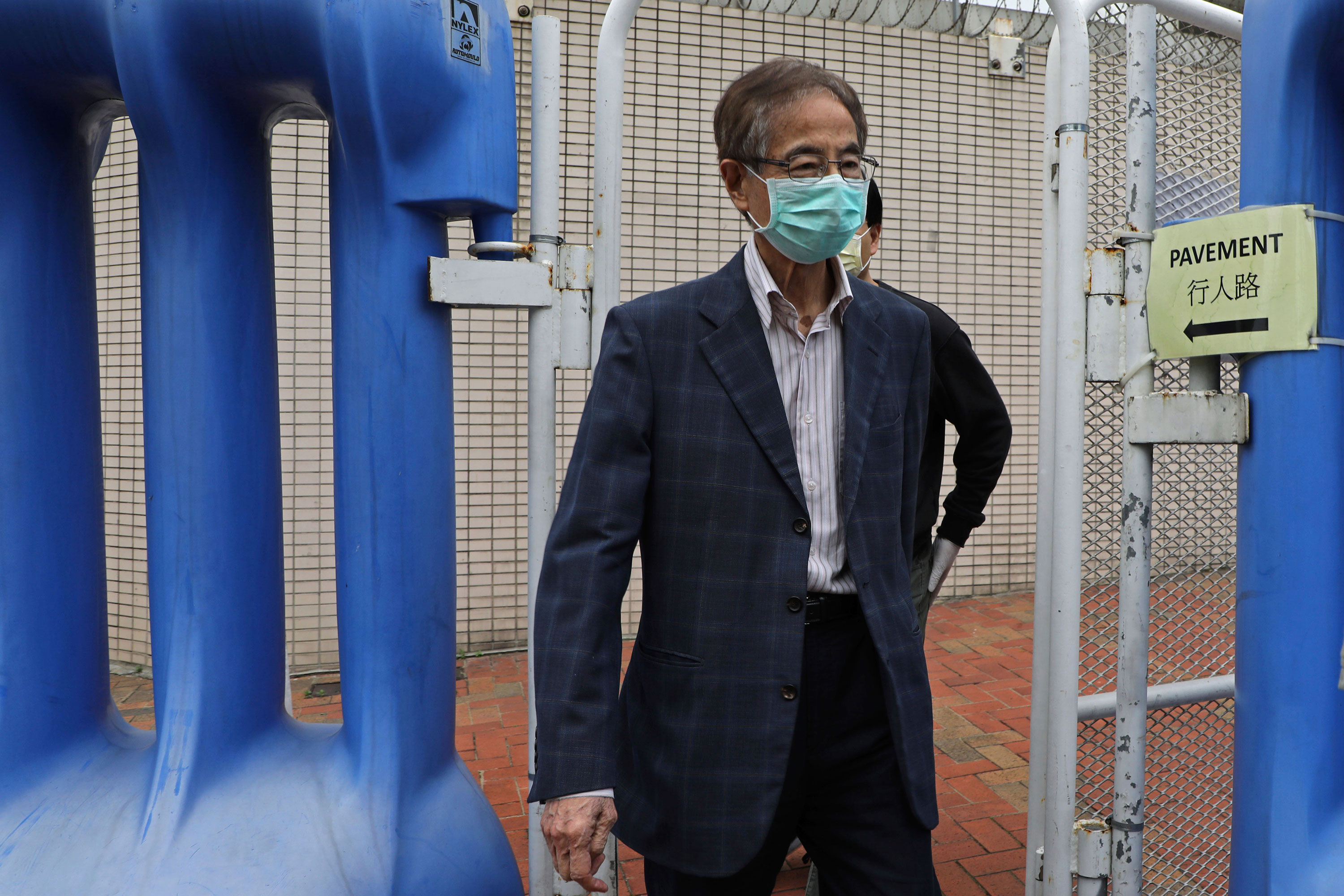 Hong Kong Democratic Party founder Martin Lee leaves a police station in Hong Kong, on April 18.