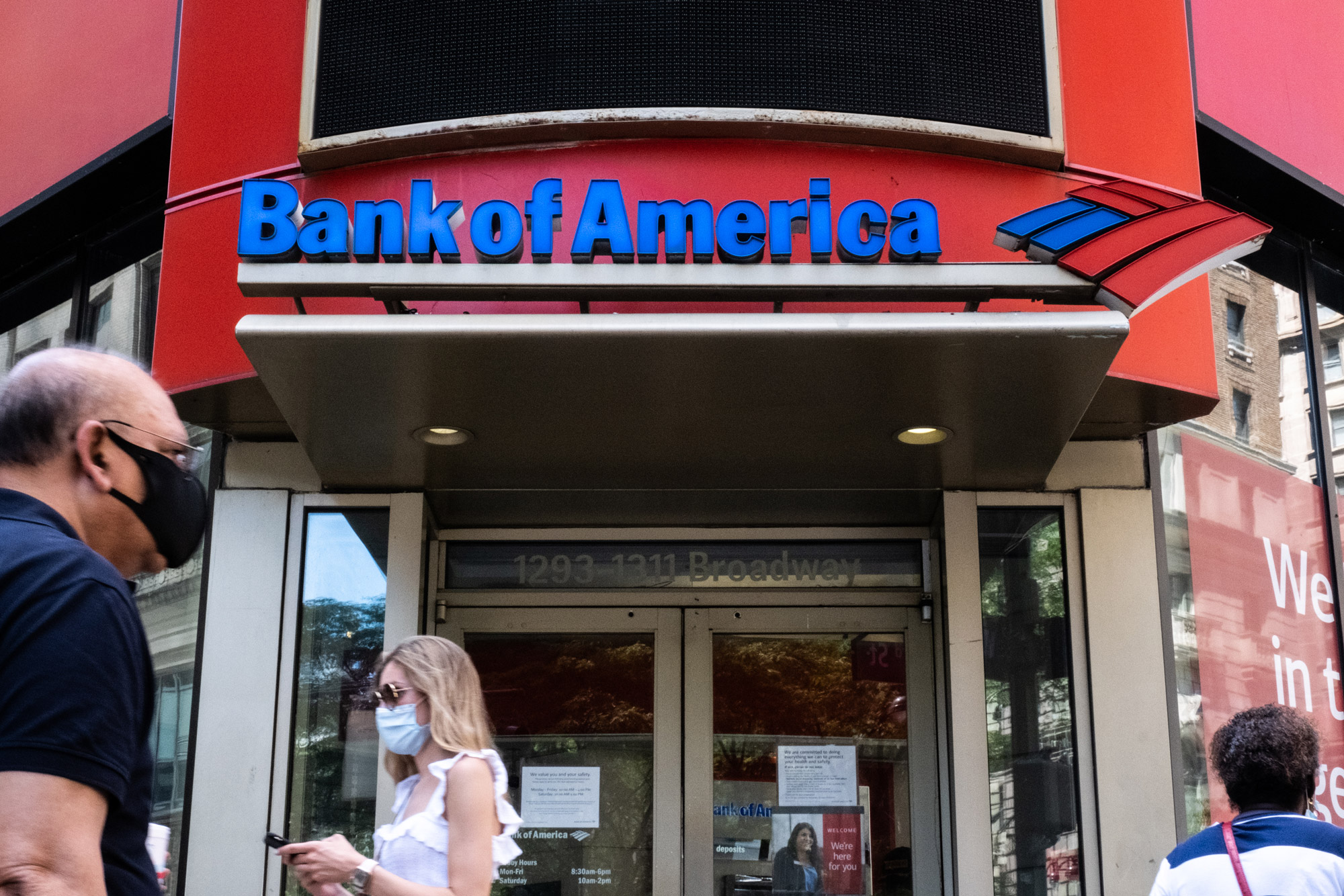 Pedestrians walk past a Bank of America Corporation branch in New York City on July 12.