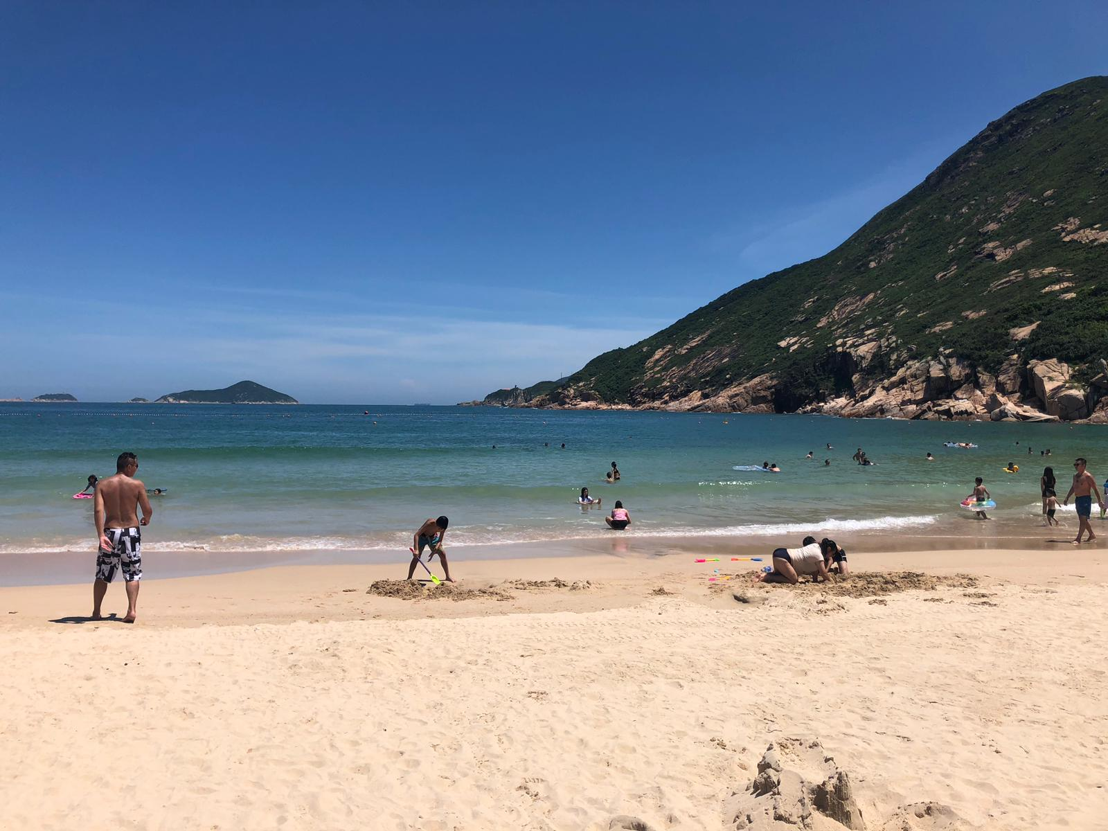 People go for a swim at Hong Kong's Shek O beach, one of the places affected by the lifeguard strike.