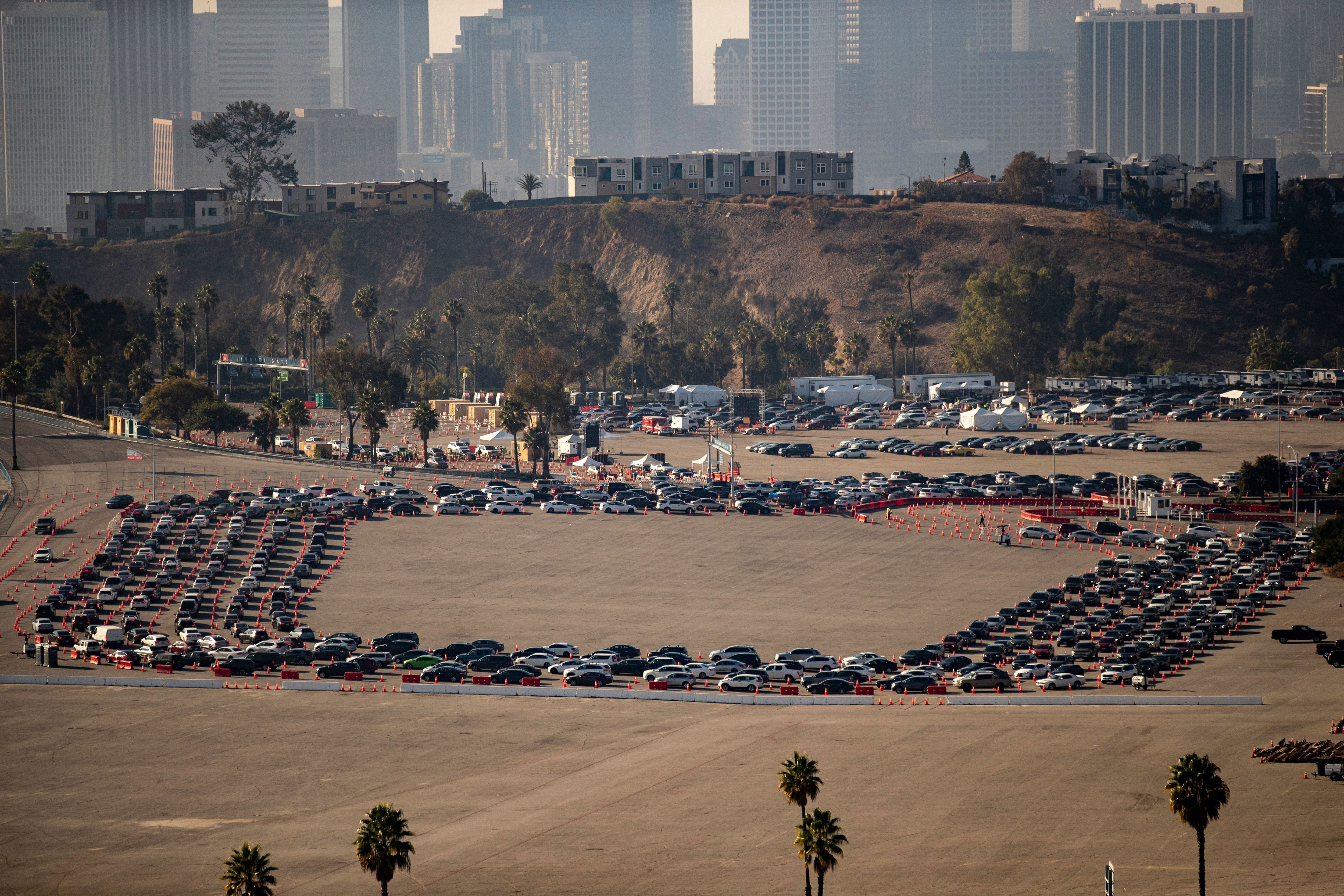 People wait in their cars to get tested for Covid-19 at Dodger Stadium in Los Angeles on January 4.