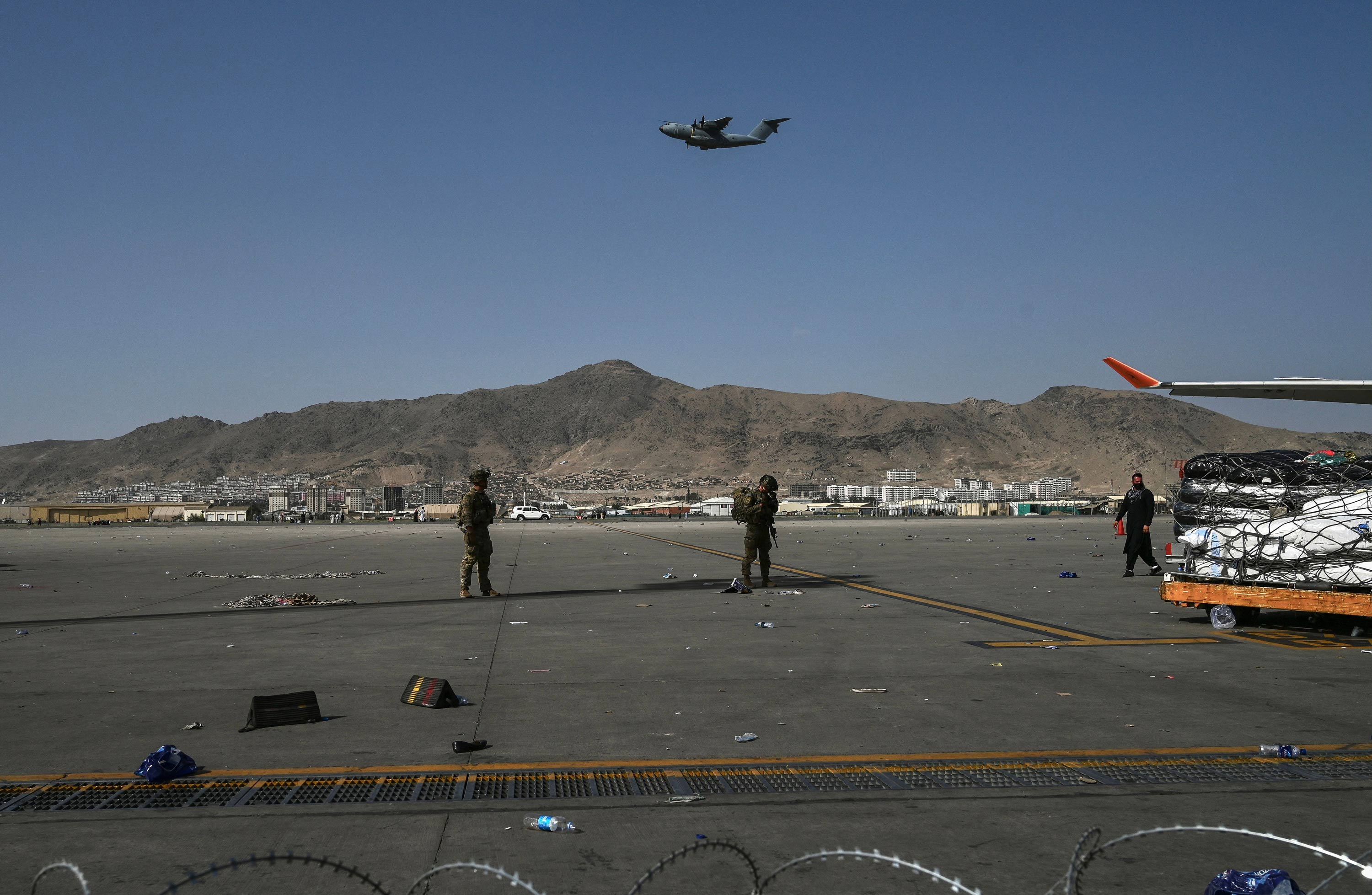 US soldiers stand guard at the Kabul airport on August 16.