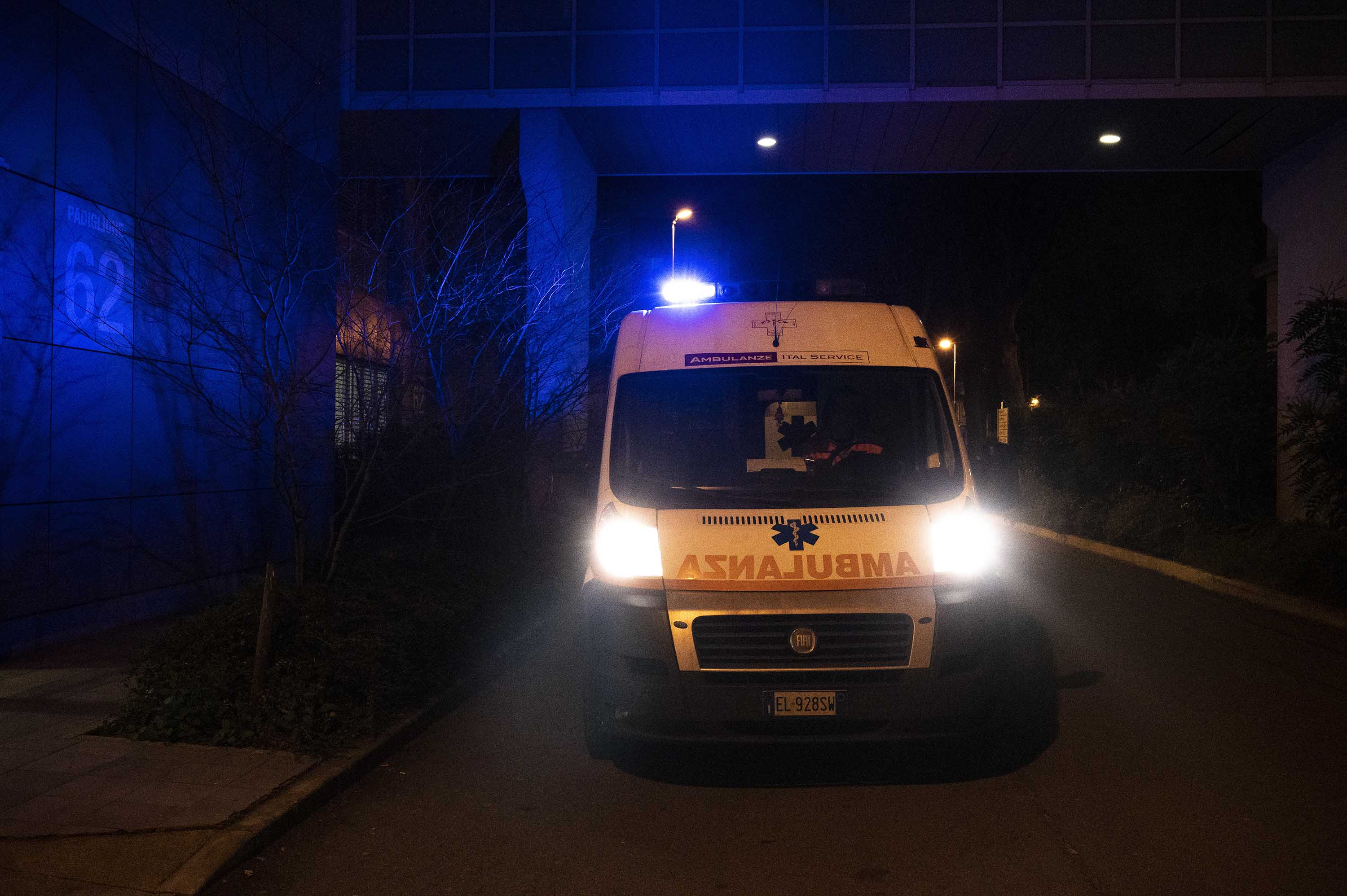 An ambulance waits in front of a medical laboratory in Milan on February 22.