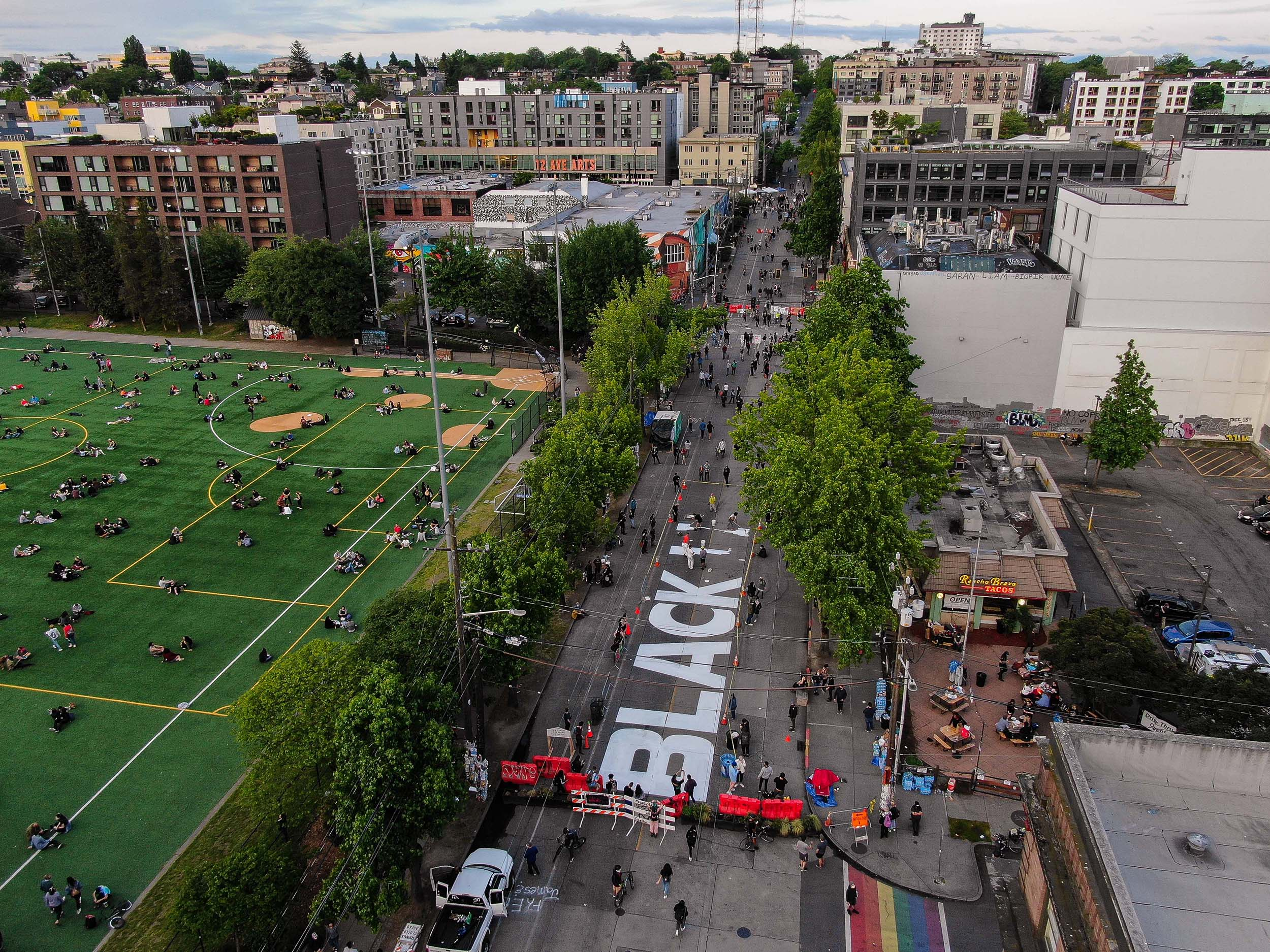 "A Black Lives Matter mural begins to take shape on East Pine Street in the so-called ""Capitol Hill Autonomous Zone"" on June 10, in Seattle, Washington."