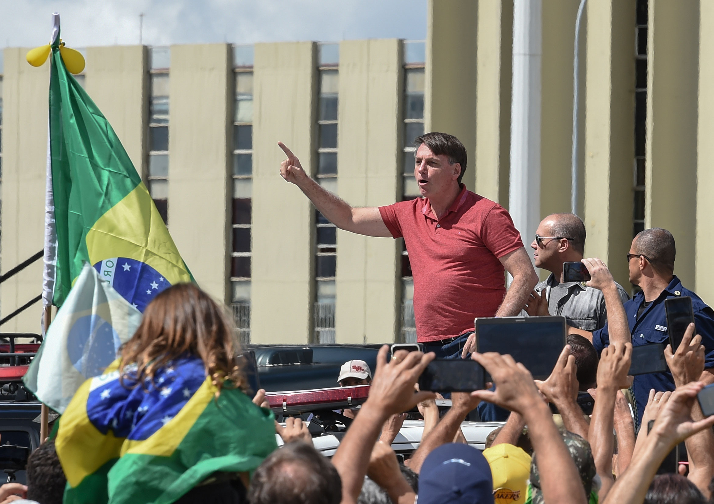Brazilian President Jair Bolsonaro speaks at a protest against quarantine and social distancing measures in Brasilia on April 19.