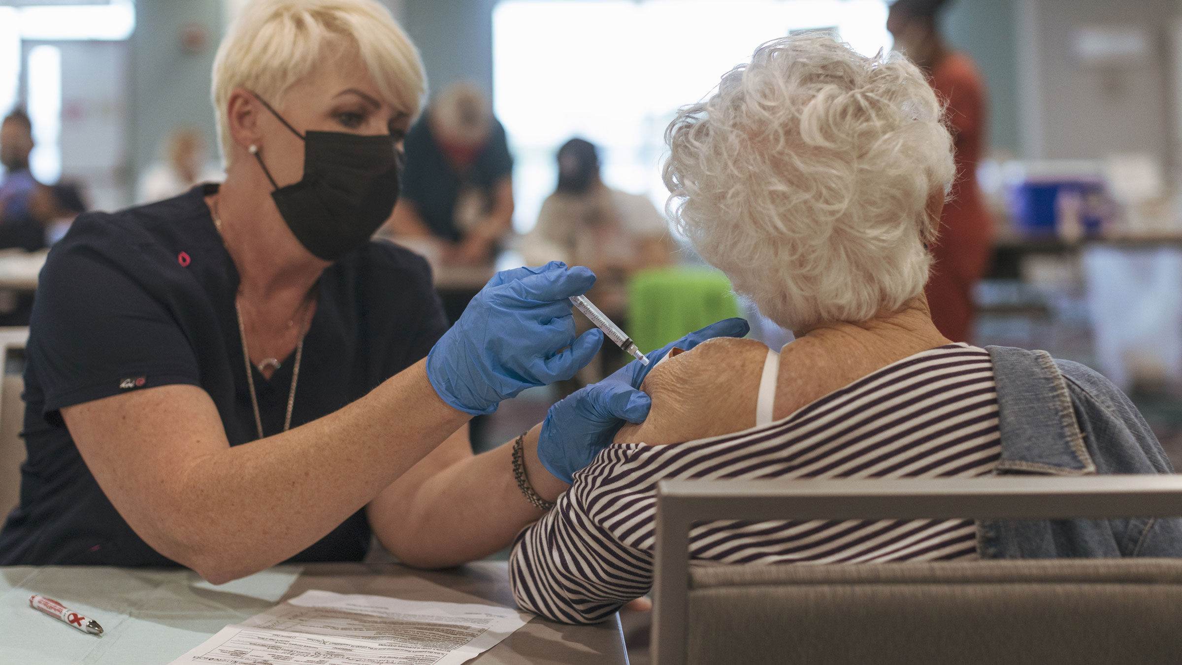 A woman receives a Covid-19 vaccine at a retirement home in Delray Beach, Florida, on Wednesday.