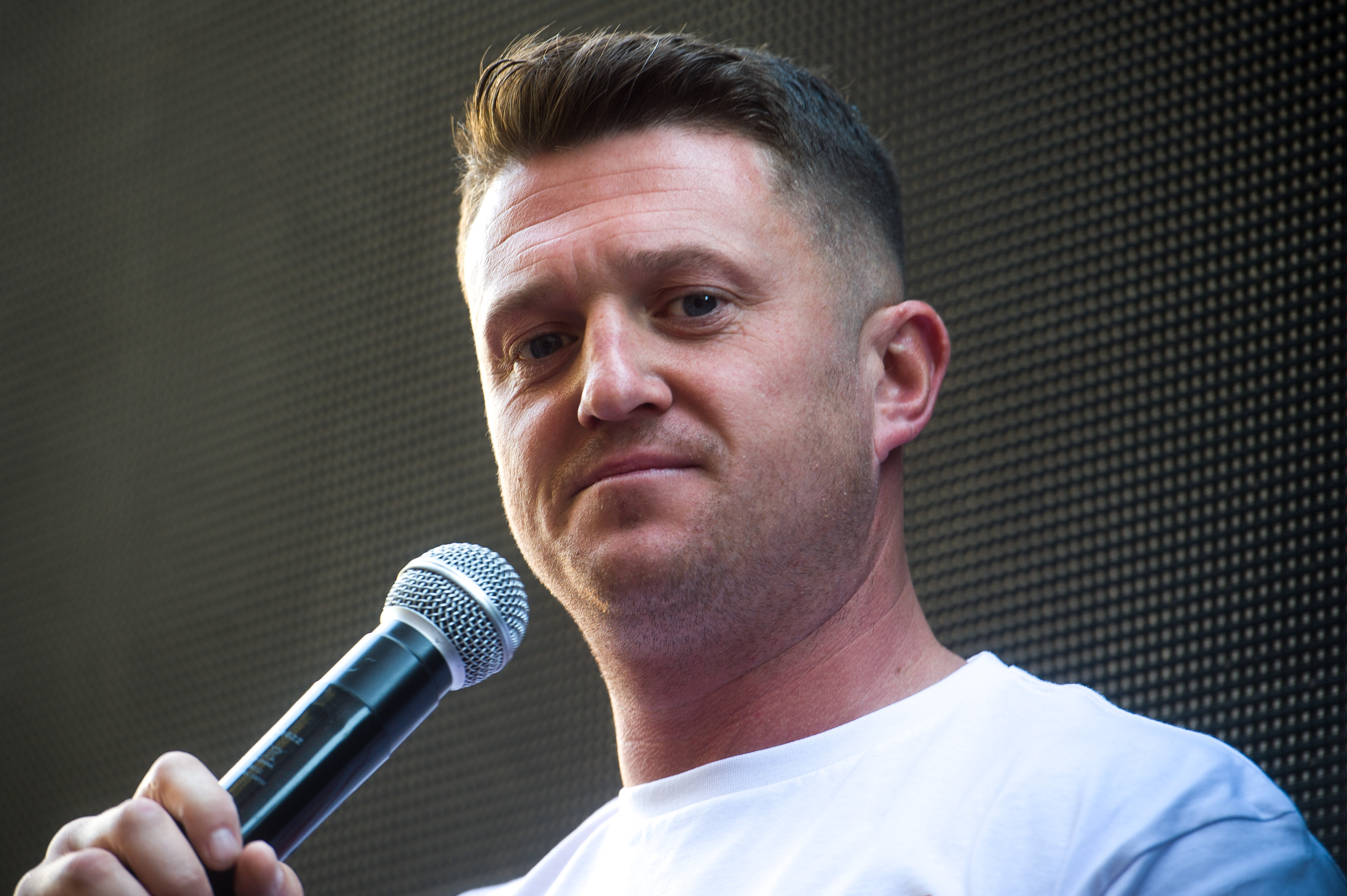 British far-right activist Tommy Robinson (real name Stephen Yaxley-Lennon) speaks to supporters outside the Old Bailey in London on May 14.