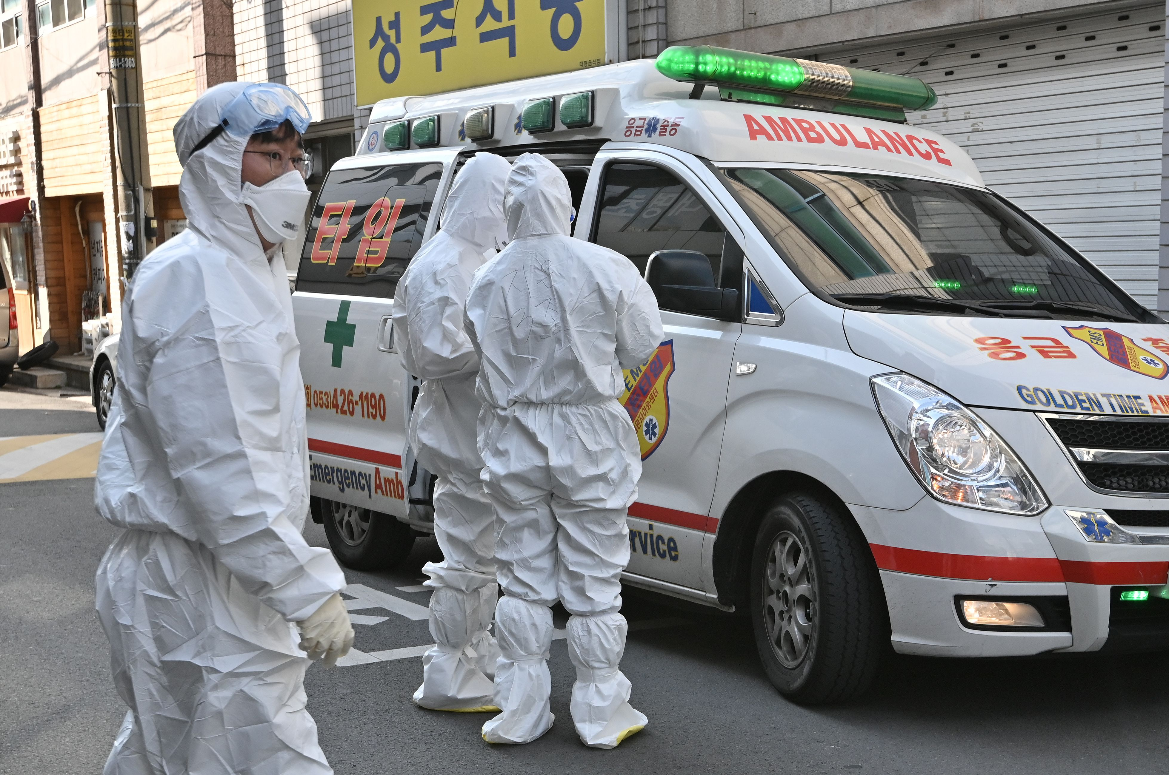 South Korean medical workers wearing protective gear visit a residence of people with suspected symptoms of the coronavirus in Daegu on Thursday.