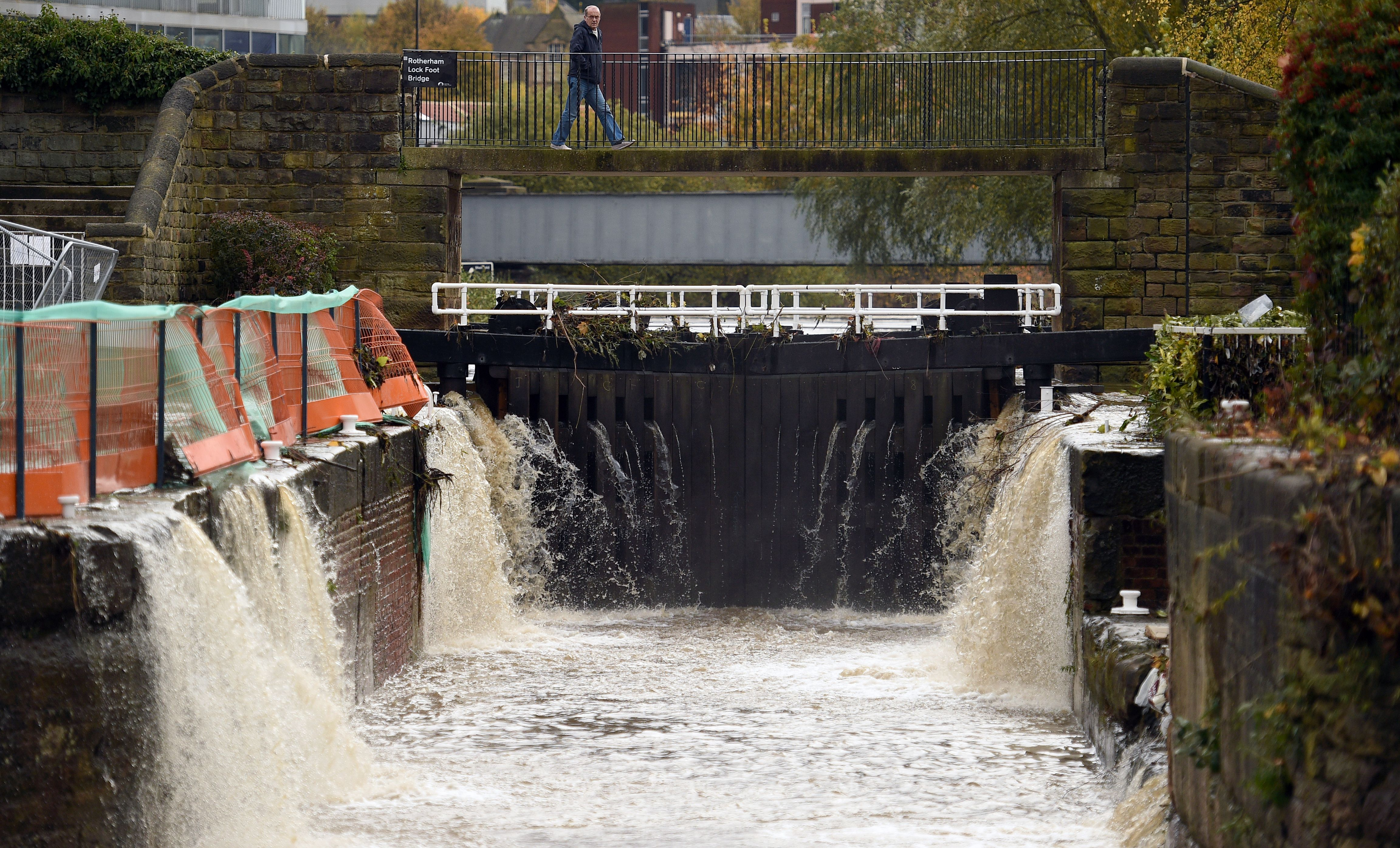 Excess surface water runs into the canal in Rotherham, northern England.