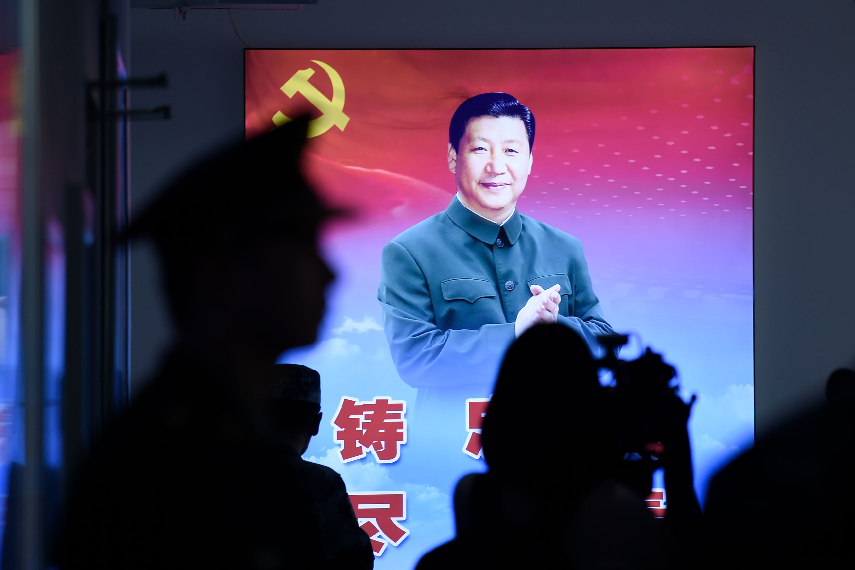 A portrait of Chinese President Xi Jinping is seen at a camp on the outskirts of Beijing on September 25, 2019.