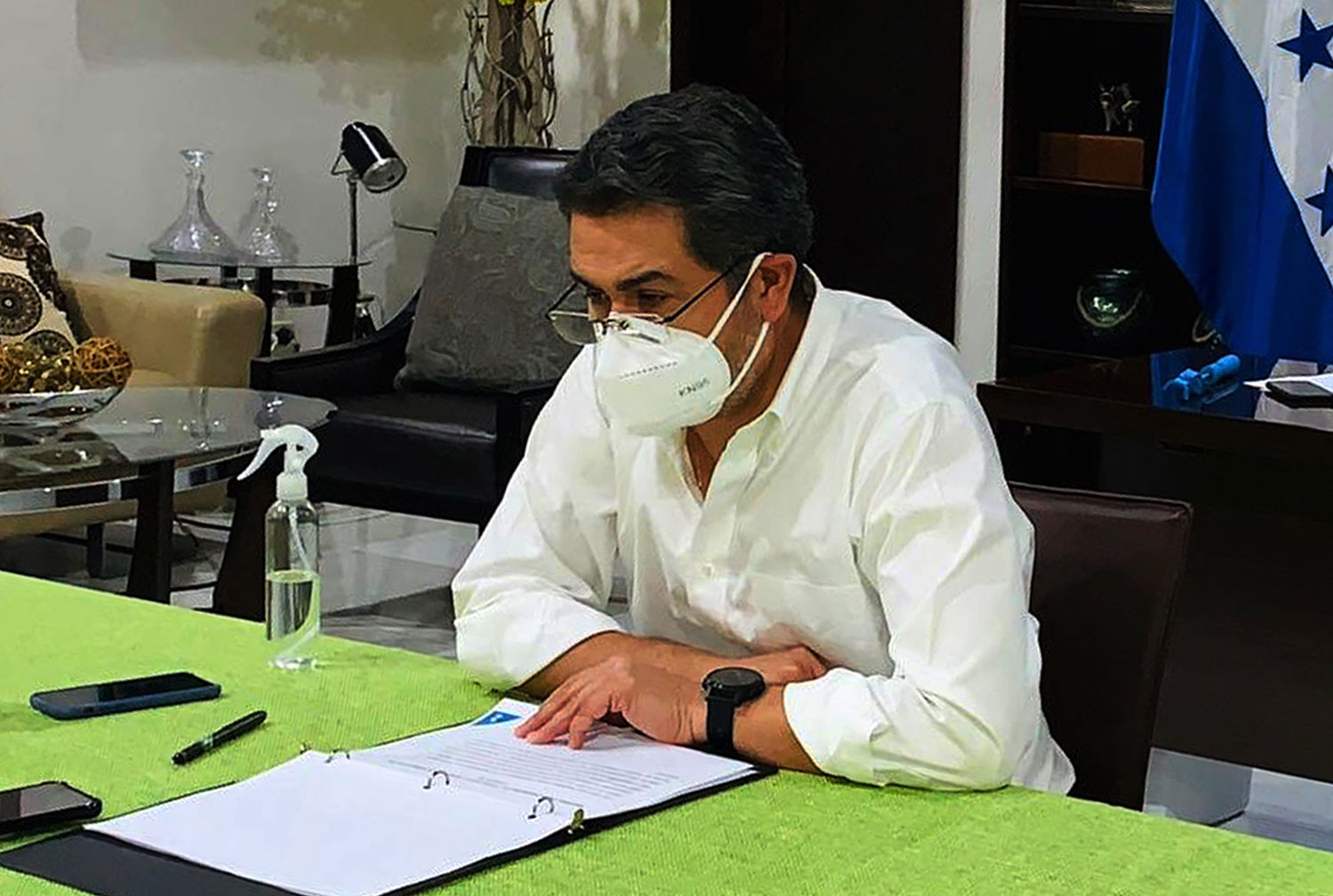 This photo taken on June 15, 2020 shows Honduran President Juan Orlando Hernandez wearing a face mask in Tegucigalpa.