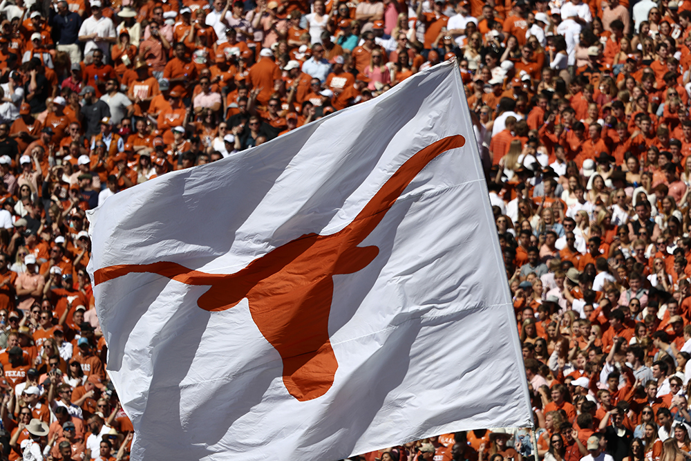 In this October 12, 2019 file photos, a Texas Longhorns flag waves during the 2019 AT&T Red River Showdown in Dallas, Texas.