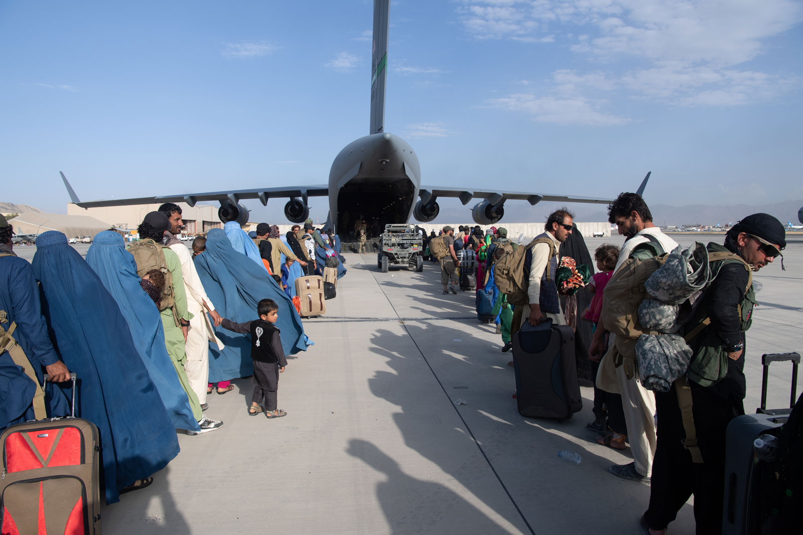 In this handout provided by U.S. Central Command Public Affairs, passengers are seen lining up to board a U.S. Air Force C-17 Globemaster III at Hamid Karzai International Airport on August 24.