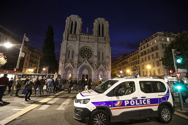 A Police vehicle is parked by the Notre-Dame de l'Assomption Basilica in Nice on Thursday, October 29.