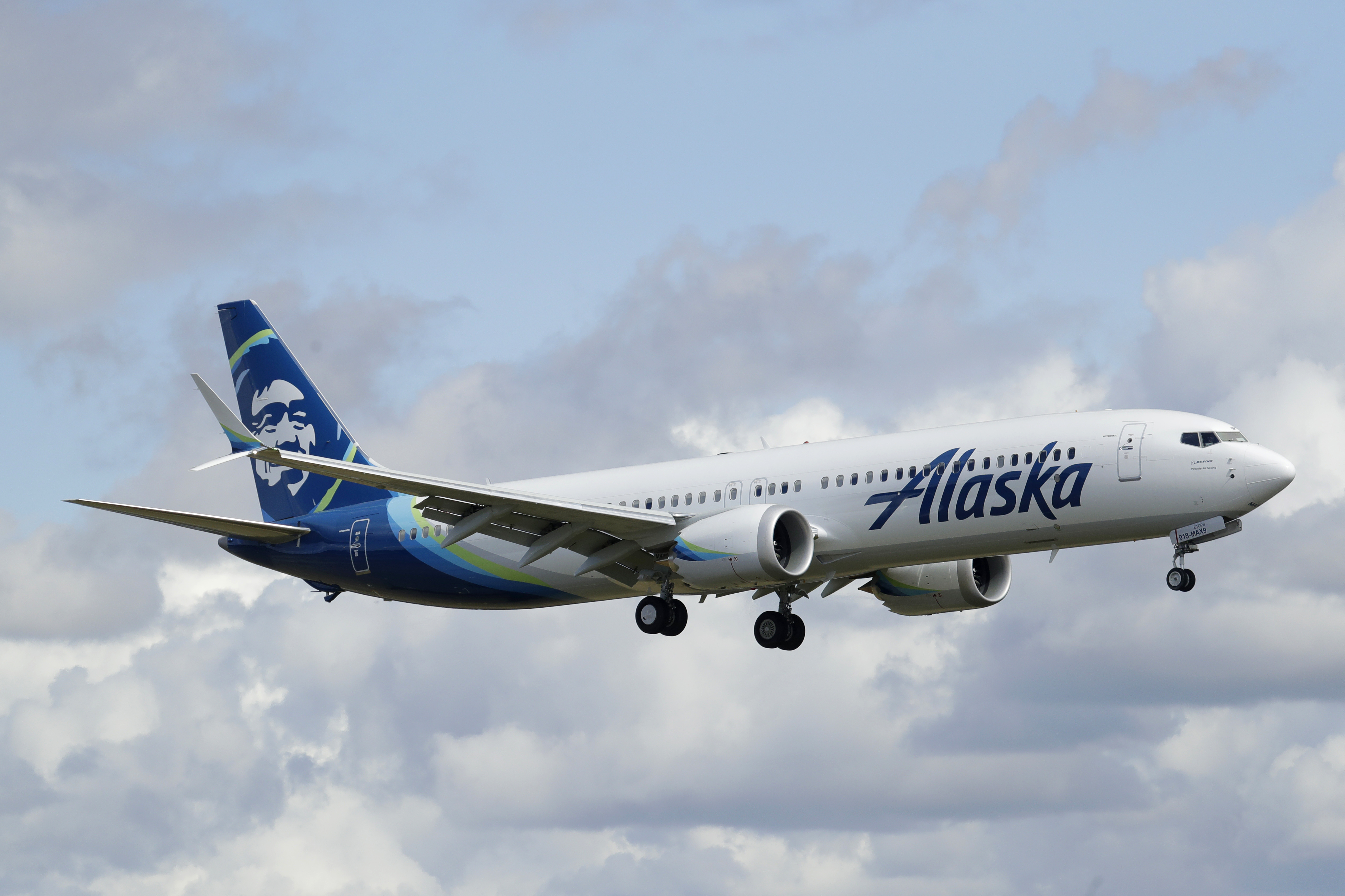 An Alaska Airlines Boeing 737-9 Max flies above Paine Field near Boeing's manufacturing facility in Everett, Washington, on March 23.