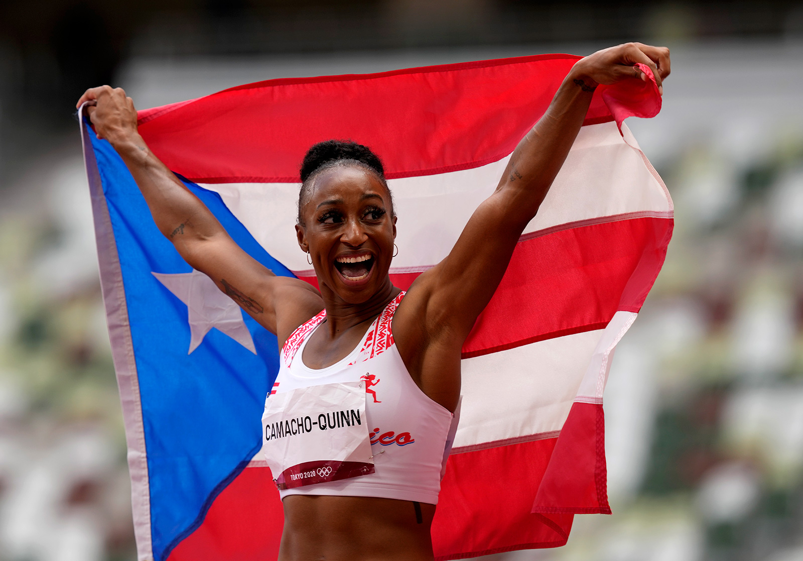 Puerto Rico's Jasmine Camacho-Quinn celebrates after winning the gold in the 100 meter hurdles final on Monday.
